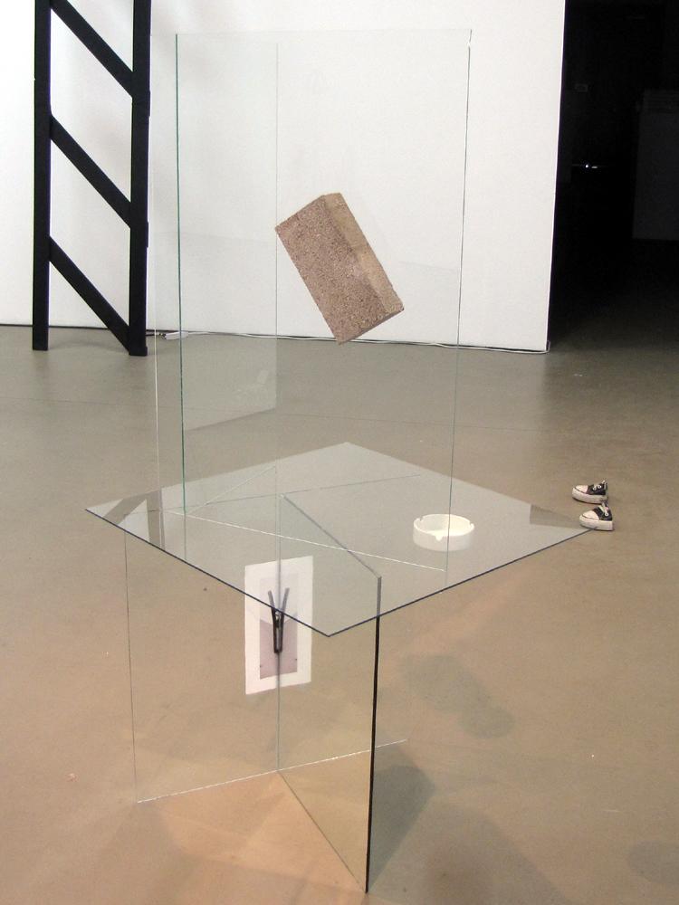 "Architect , 58"" x 21"" x 22"", transparent glass, mirror glass, found ashtray, concrete brick, inkjet print on paper, silicon, 2010"