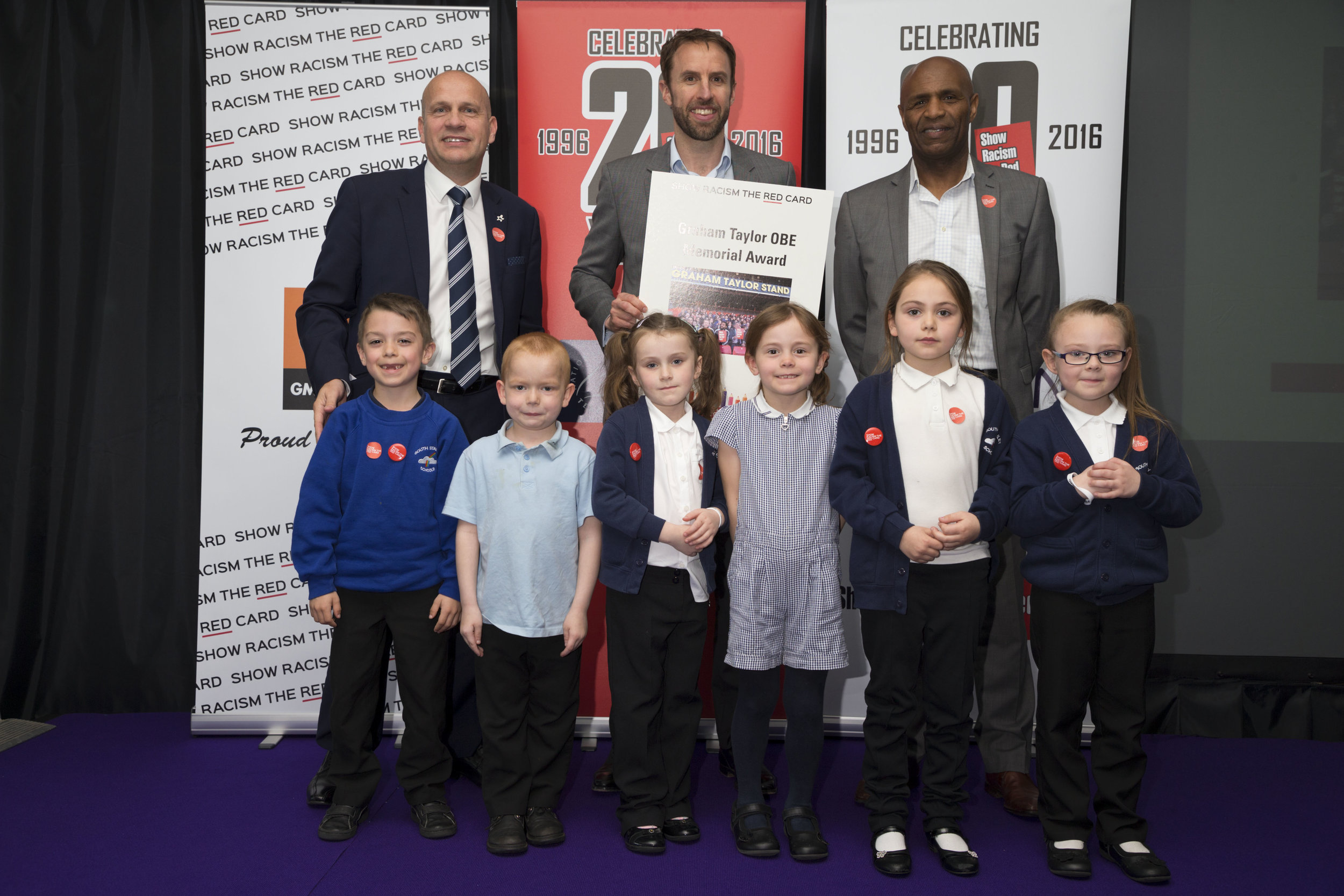 Young people from South Stanley Infants win Graham Taylor Memorial Award, with John Hudson, Gareth Southgate and Luther Blissett
