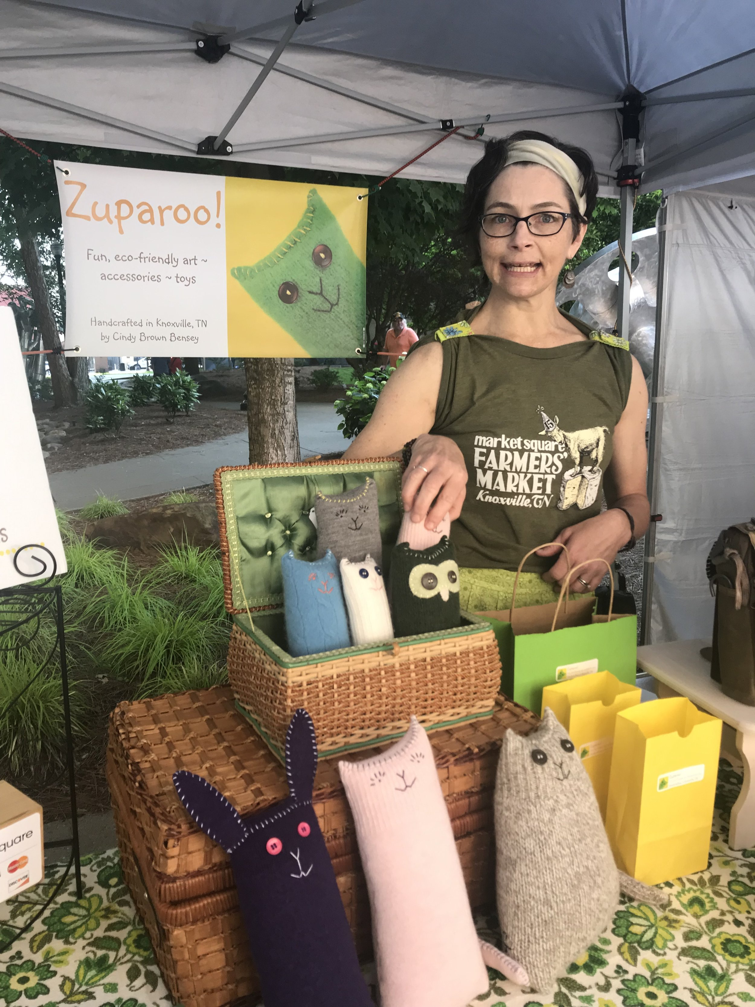 Cindy Bensey shares space with warm and fuzzy friends at the Zuparoo! booth