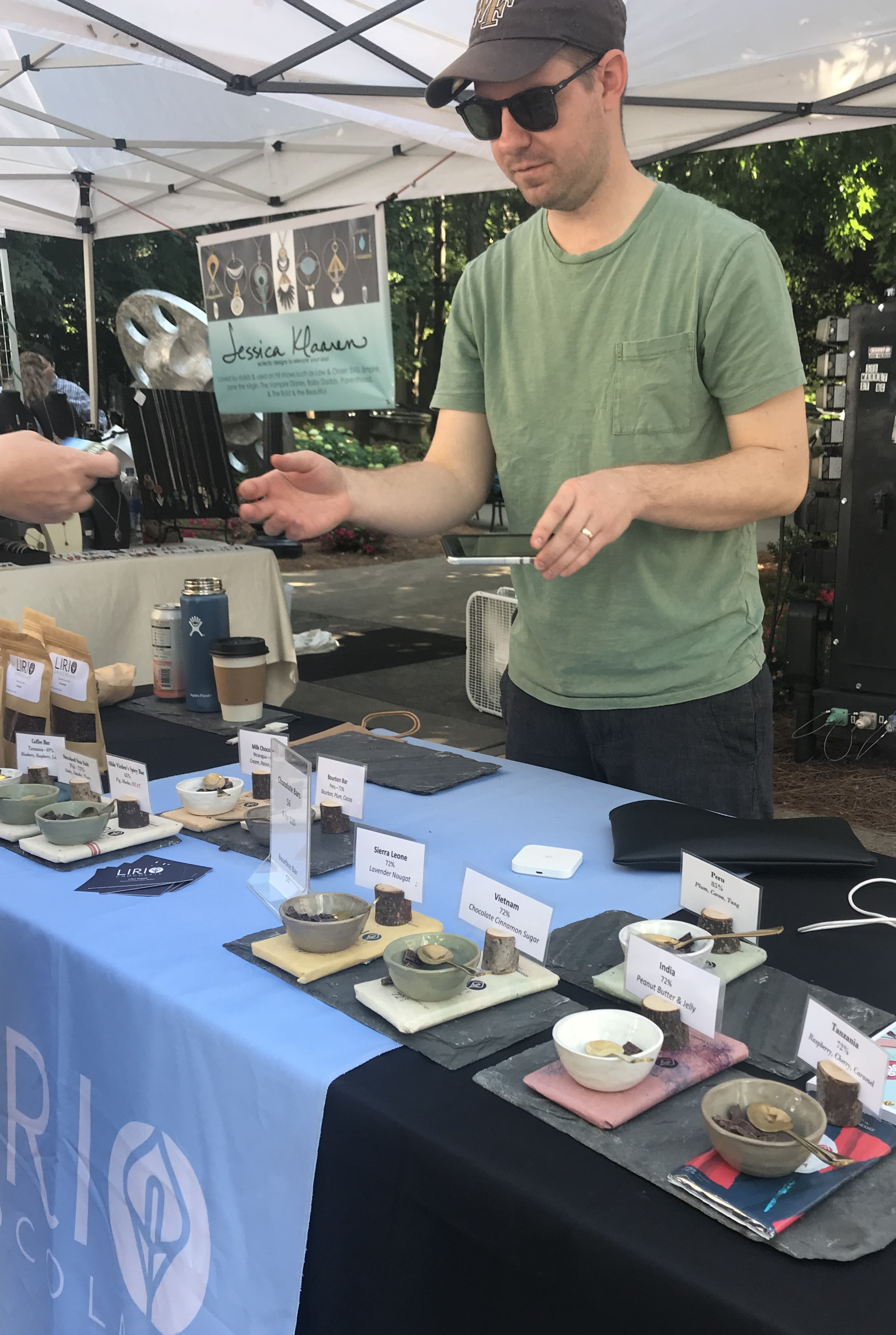 Chris Kopek transacts a sale at his Lirio Chocolate booth