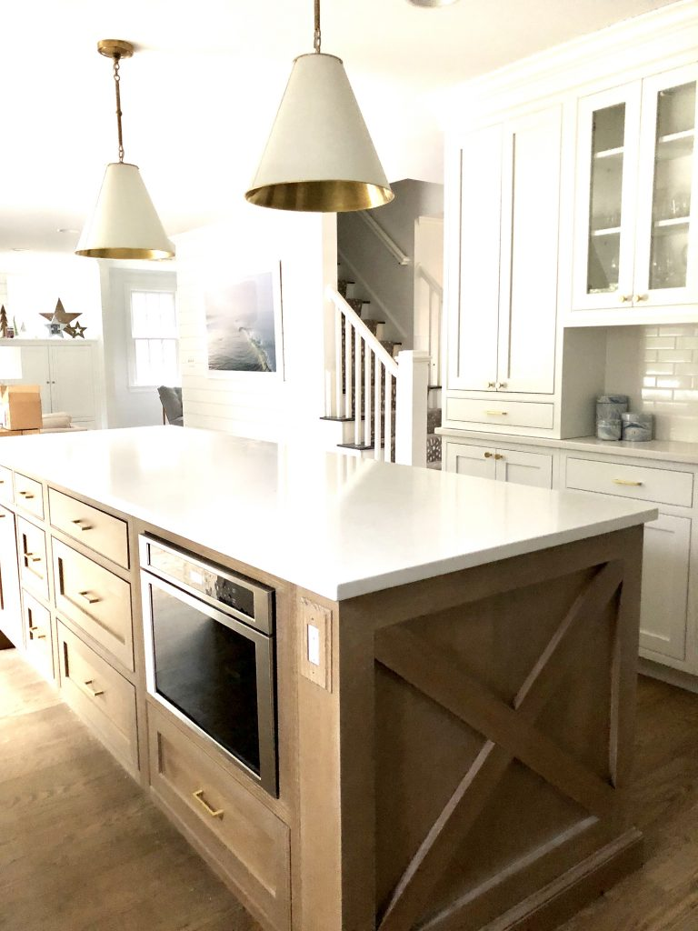 The oak kitchen island has a cerused finish that highlights the natural grain of the wood.