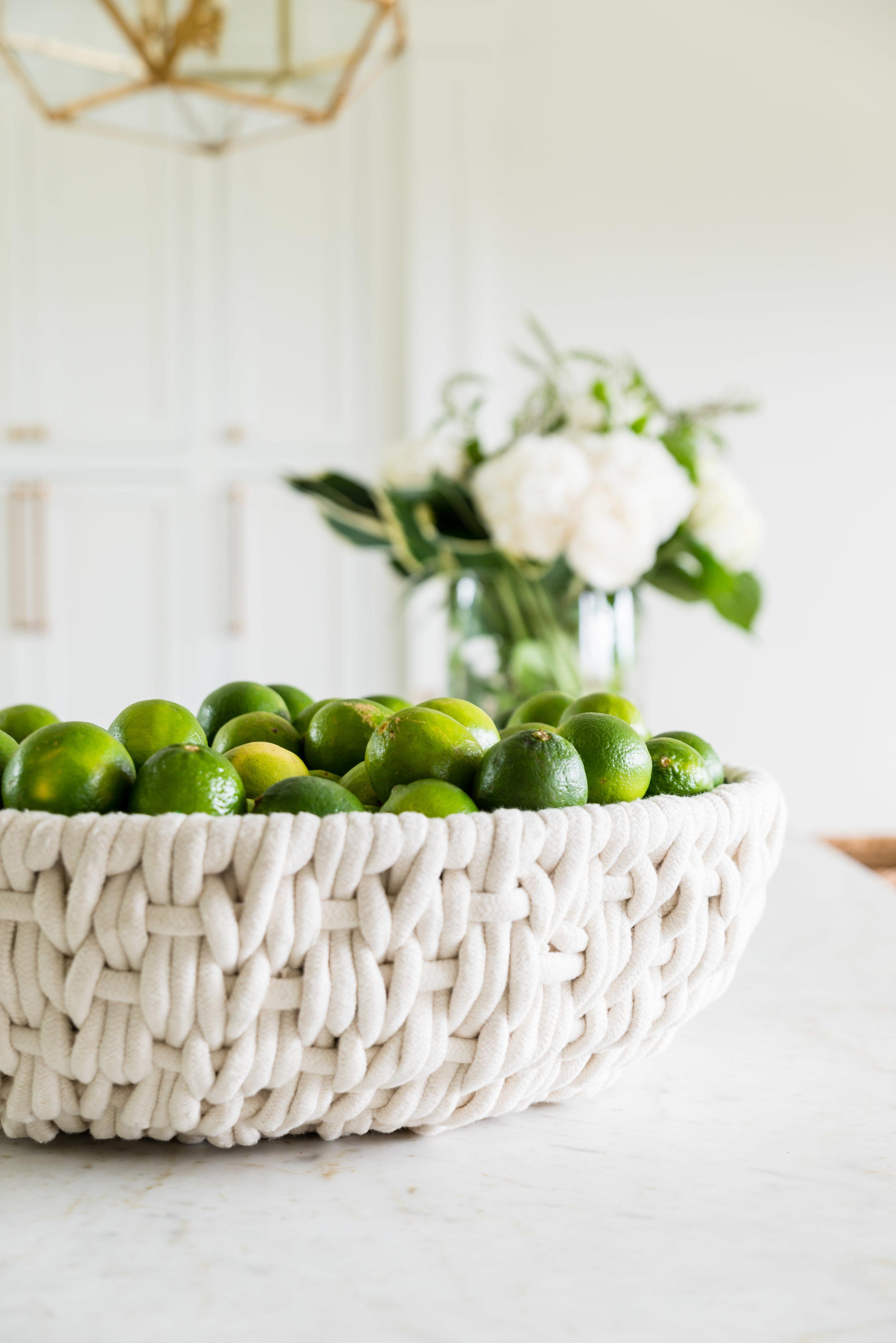 A rope bowl full of lemons