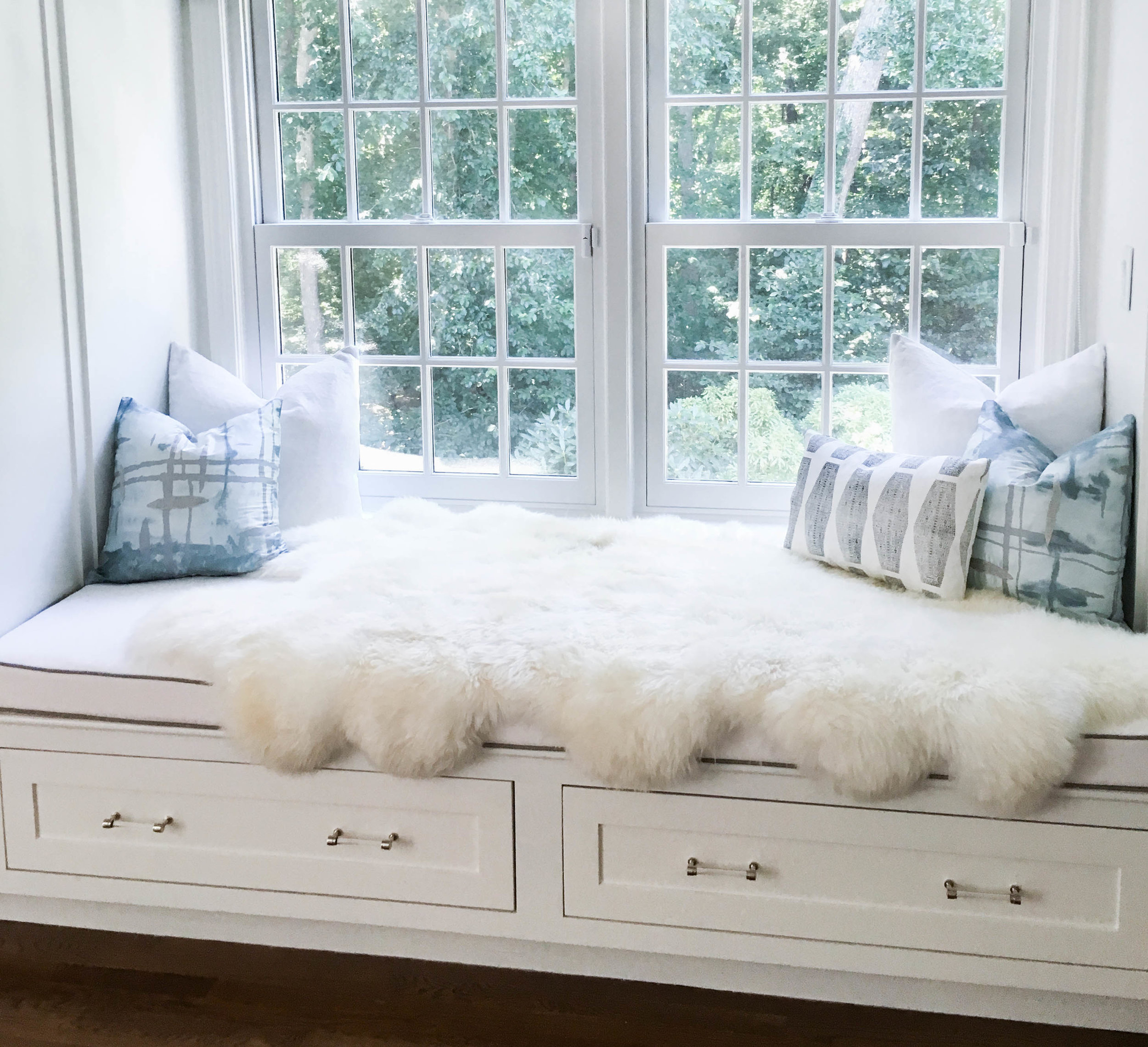 A daybed in our client's bedroom is draped in a sheepskin rug for extra coziness.