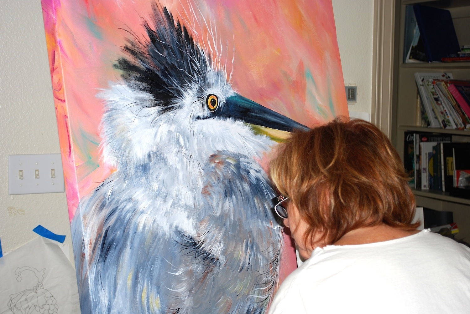 duckie painting baby heron in studio.JPG