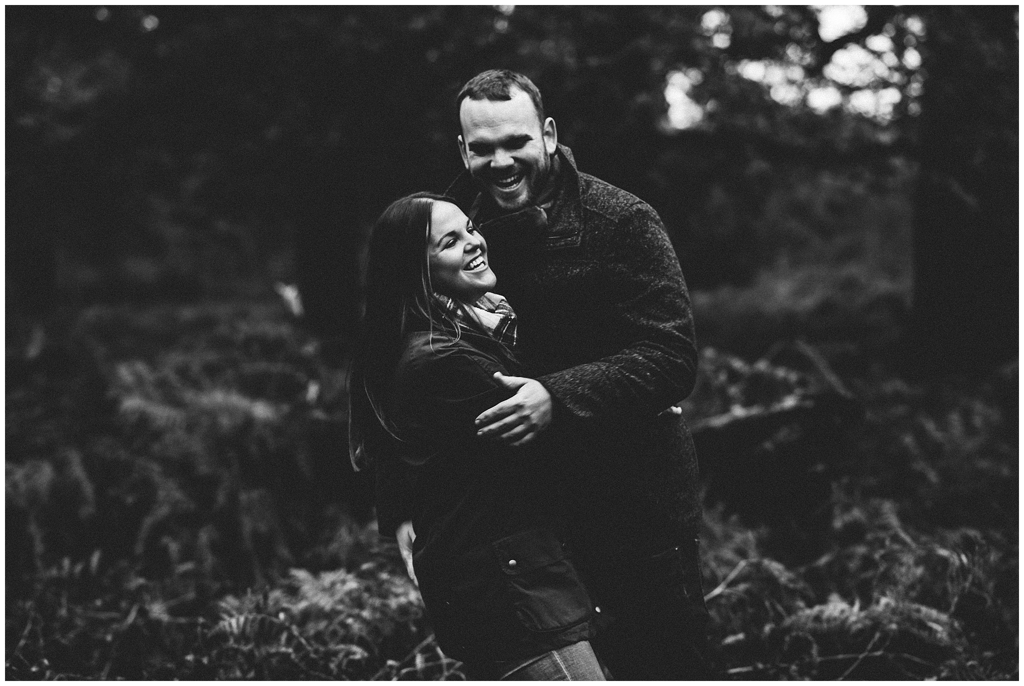 black and white photo of couple laughing together. Cheshire lifestyle photographer
