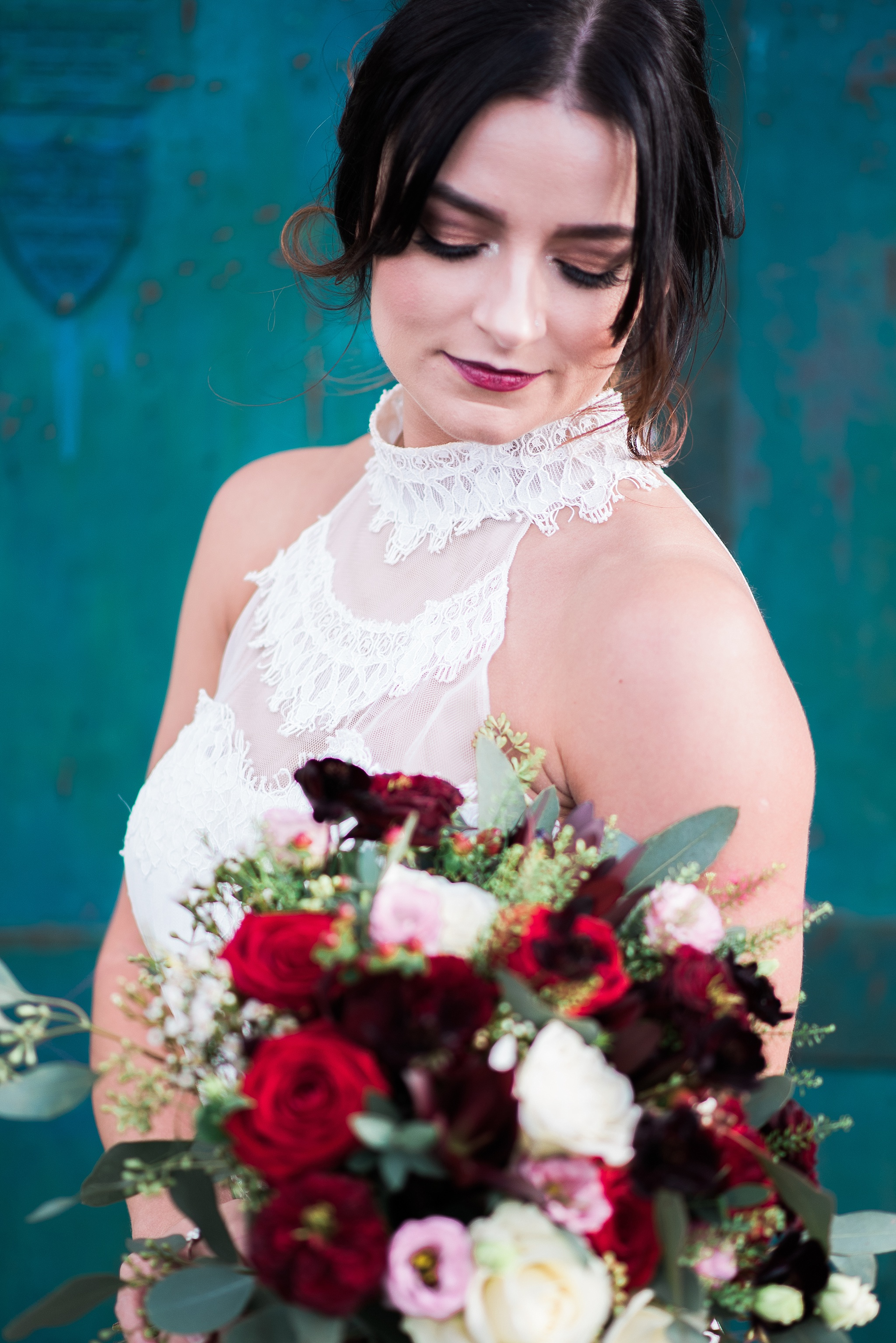 Portrait of the bride in her vintage style wedding dress with halterneck lace detail.