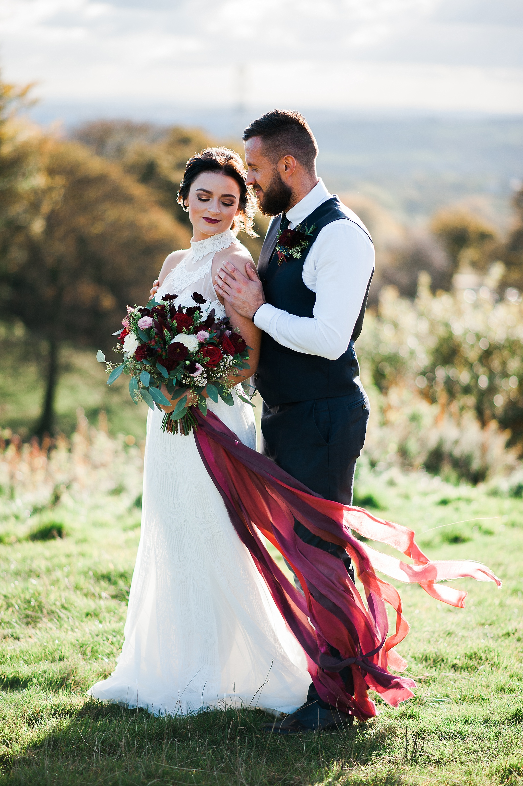 Portrait of the bride and groom with views of Lancashire in the background. Bolton wedding photography