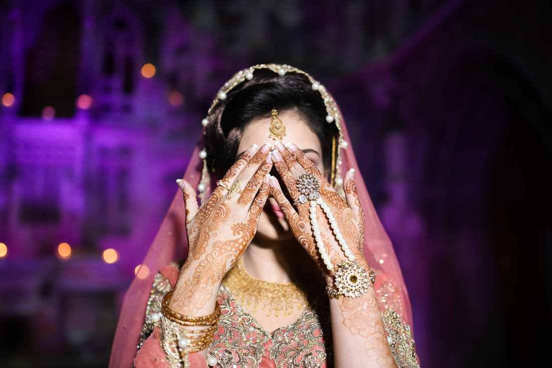 Asian bride holding her hands up to show henna. Manchester Monastery wedding photography