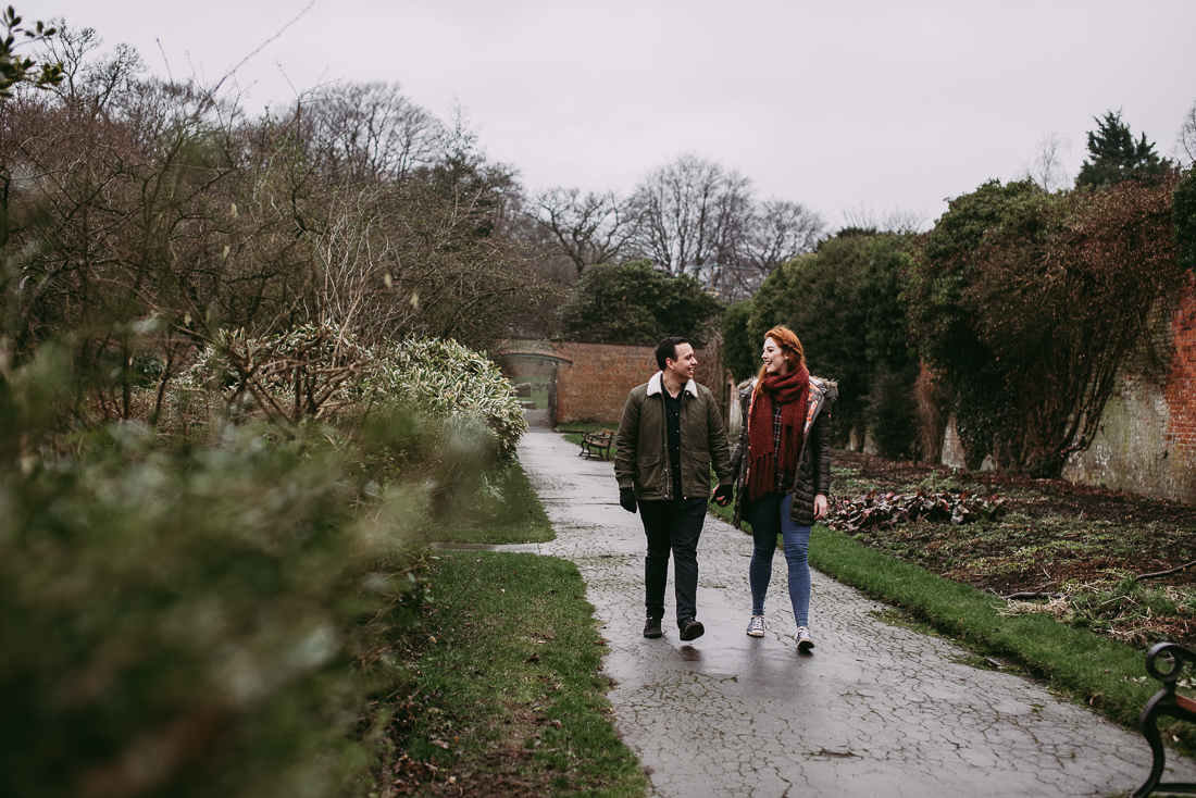 Walking together in the gardens at Haigh Hall. Engagement Photography