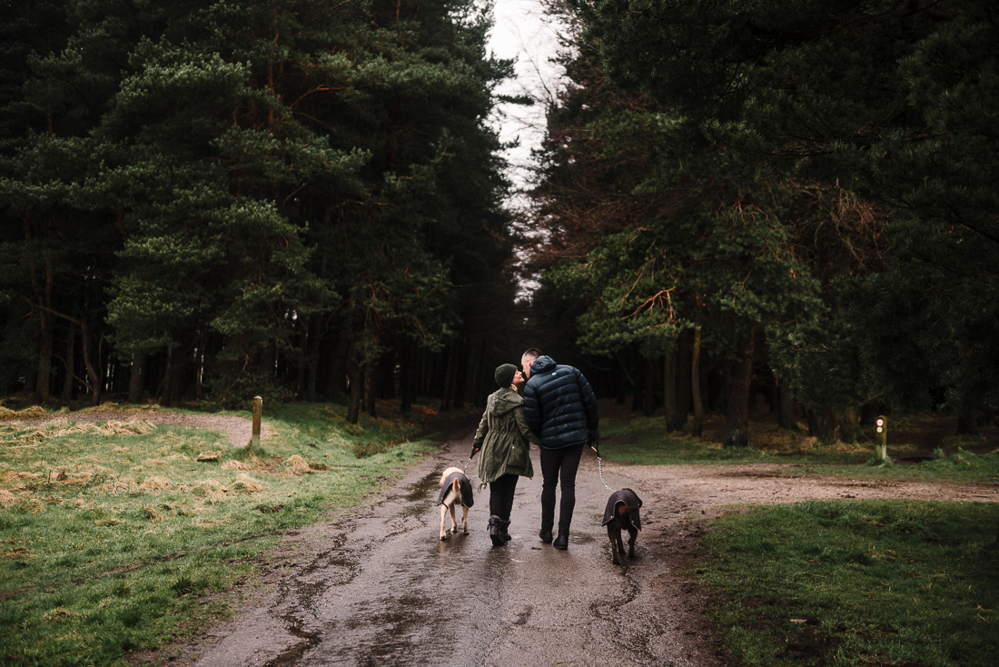 Couple and their dogs walking in Hurstwood, Burnley, Lancashire.