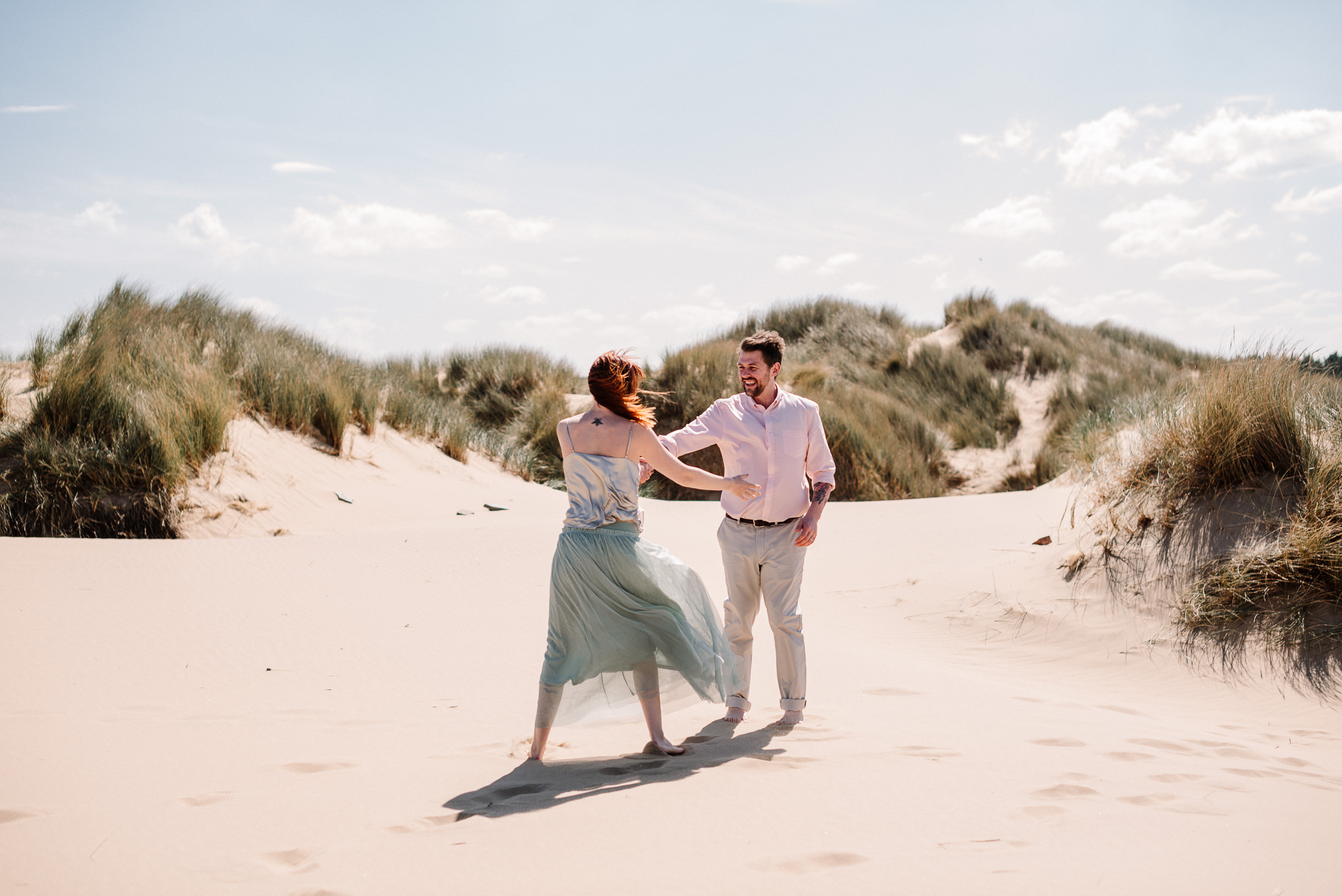 Alternative bride and groom on the beach at Formby