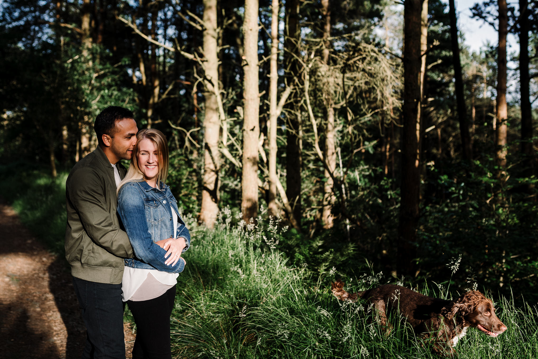 couple stood together in the woods. Bolton photographer