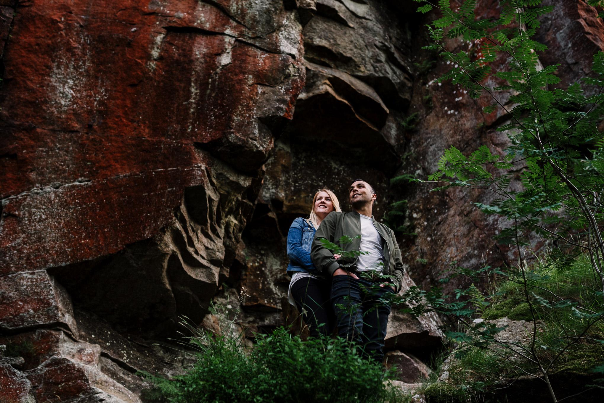 Infront of cliff face at Entwistle Reservoir. Lancashire lifestyle photographer