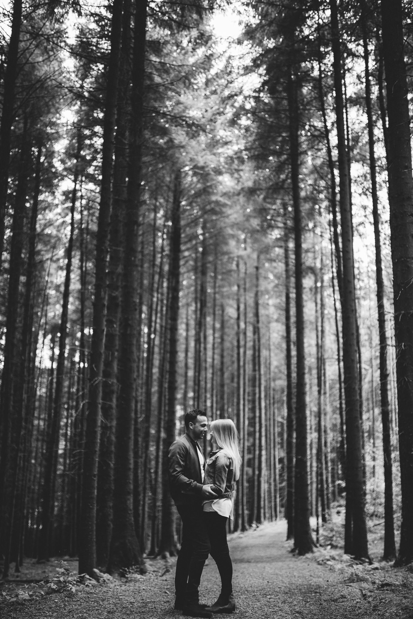 Stood together on a path in between tall trees. Lancashire lifestyle photography