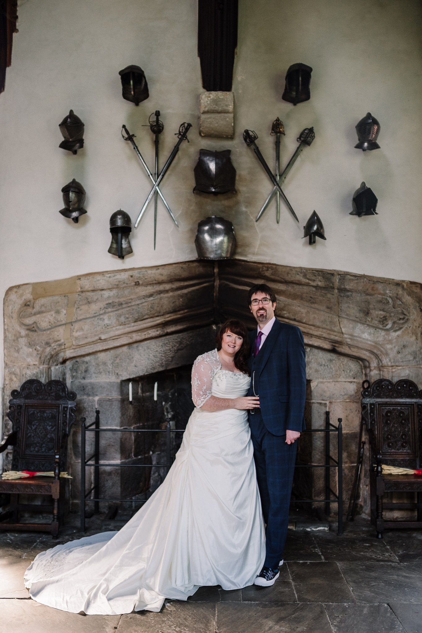Bride and groom in front of armoured wall