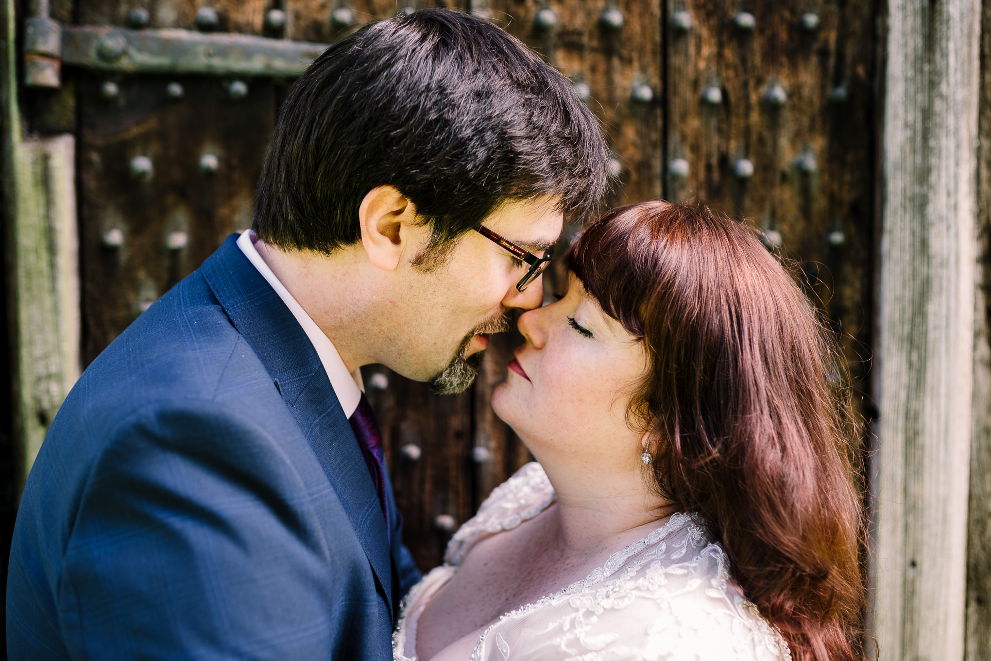 Close up photograph of bride and groom kissing outside Rufford Old Hall. Lancashire wedding photography.
