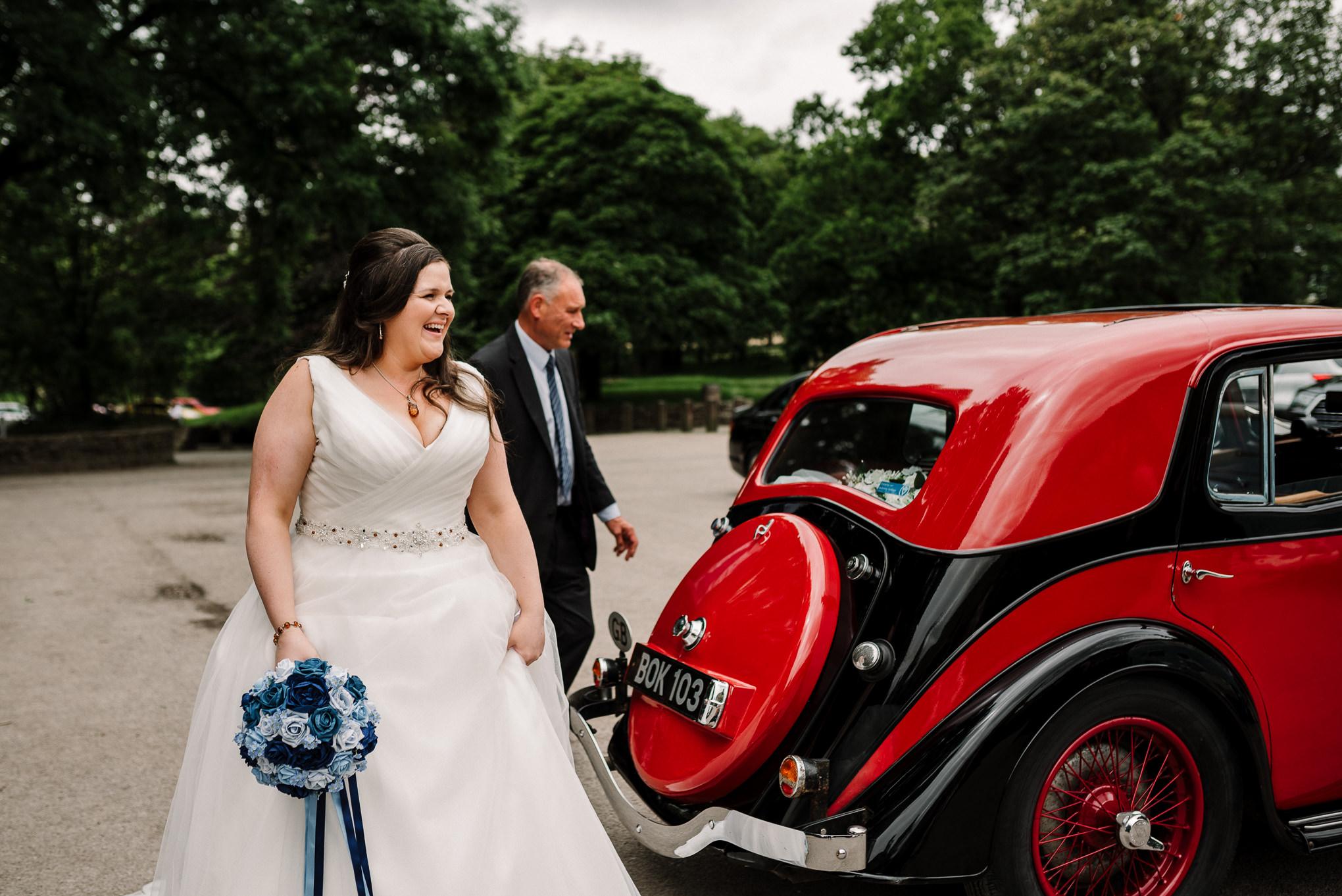 Natural shot of the bride as she arrives at Rivington Hall Barn.