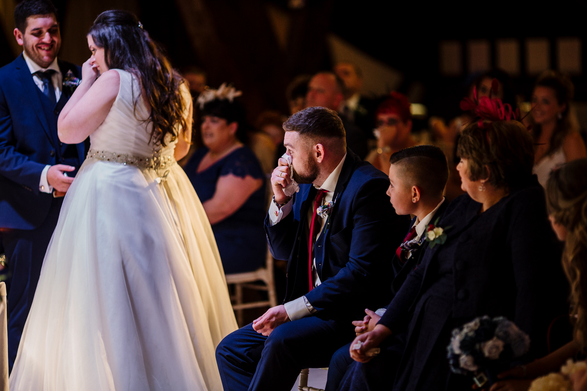 Documentary photo of brides brother crying during the wedding ceremony.