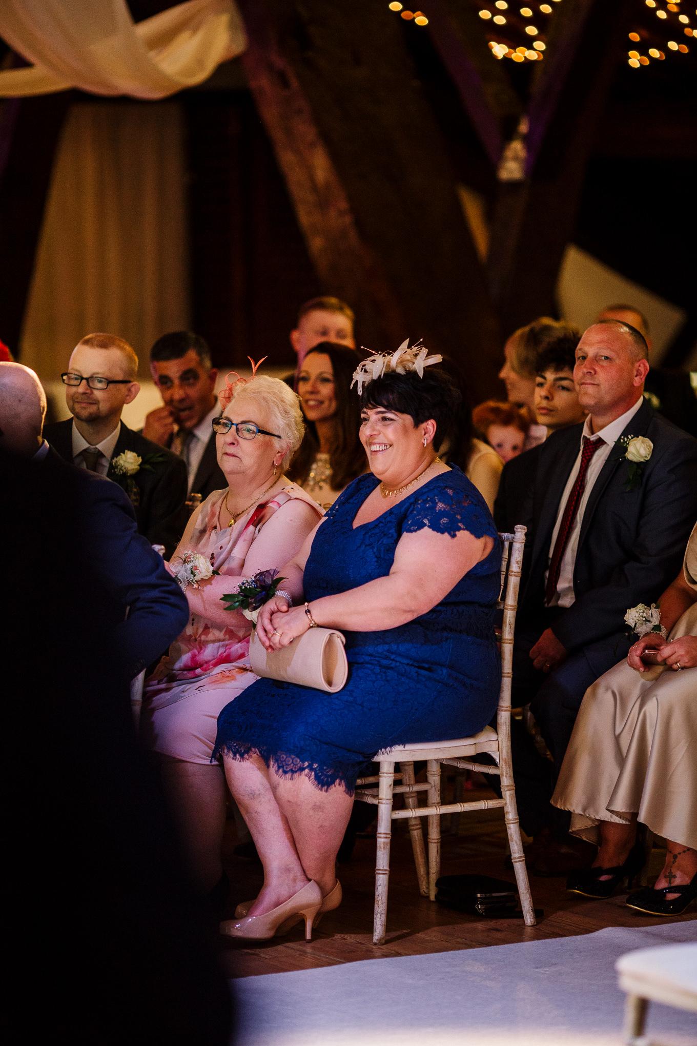 Grooms mum during wedding ceremony