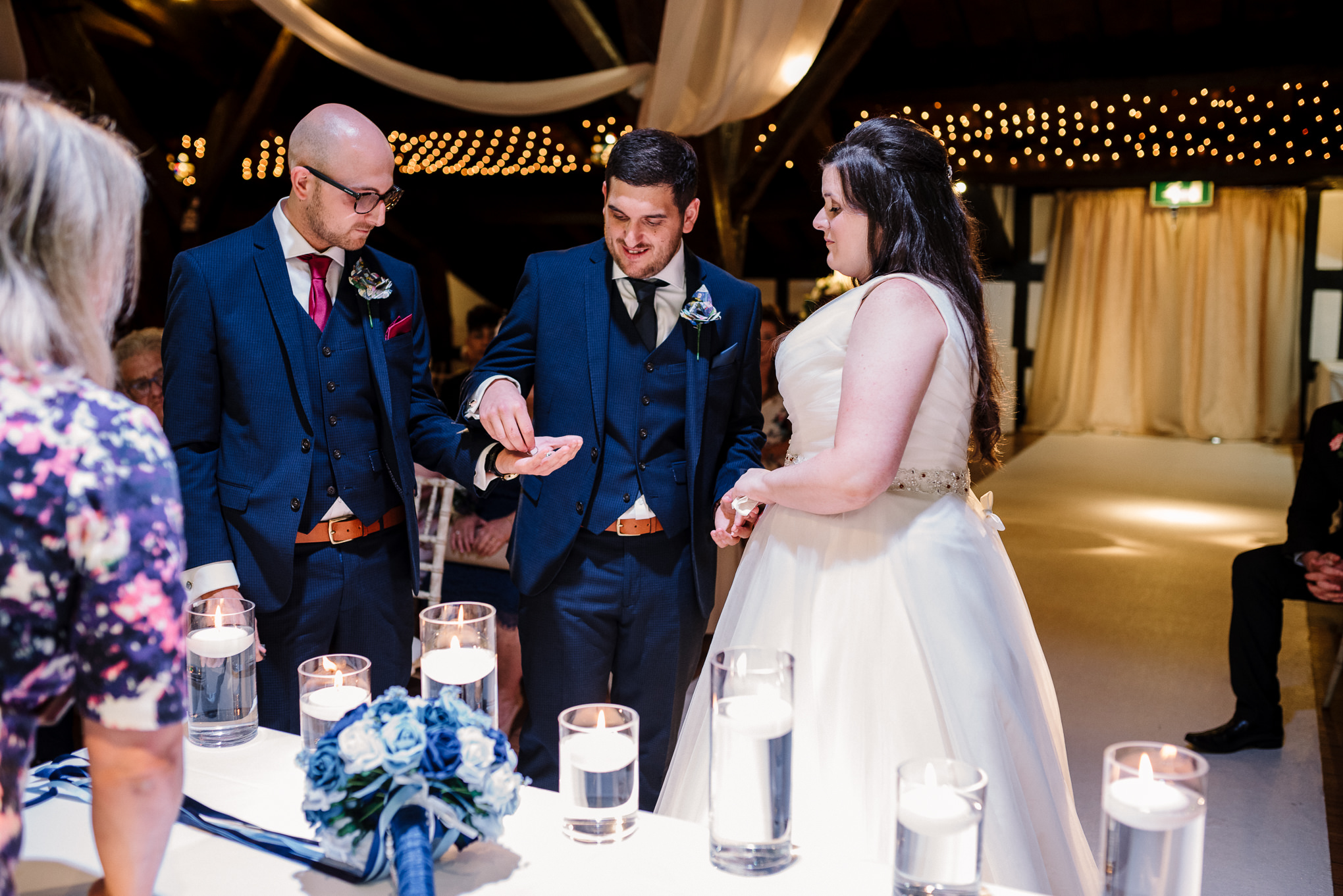 Best man passing wedding ring to the groom.