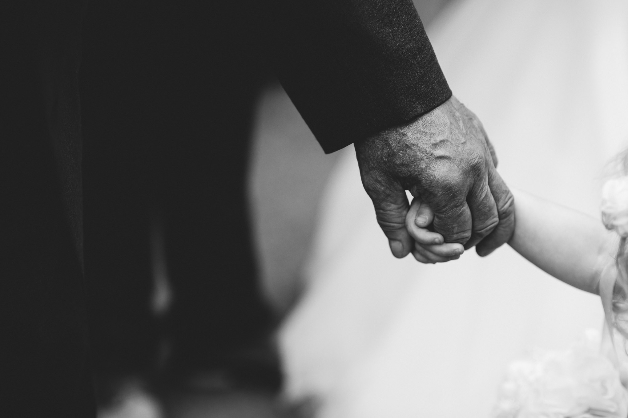 Black and white photo of hands. Natural wedding photography