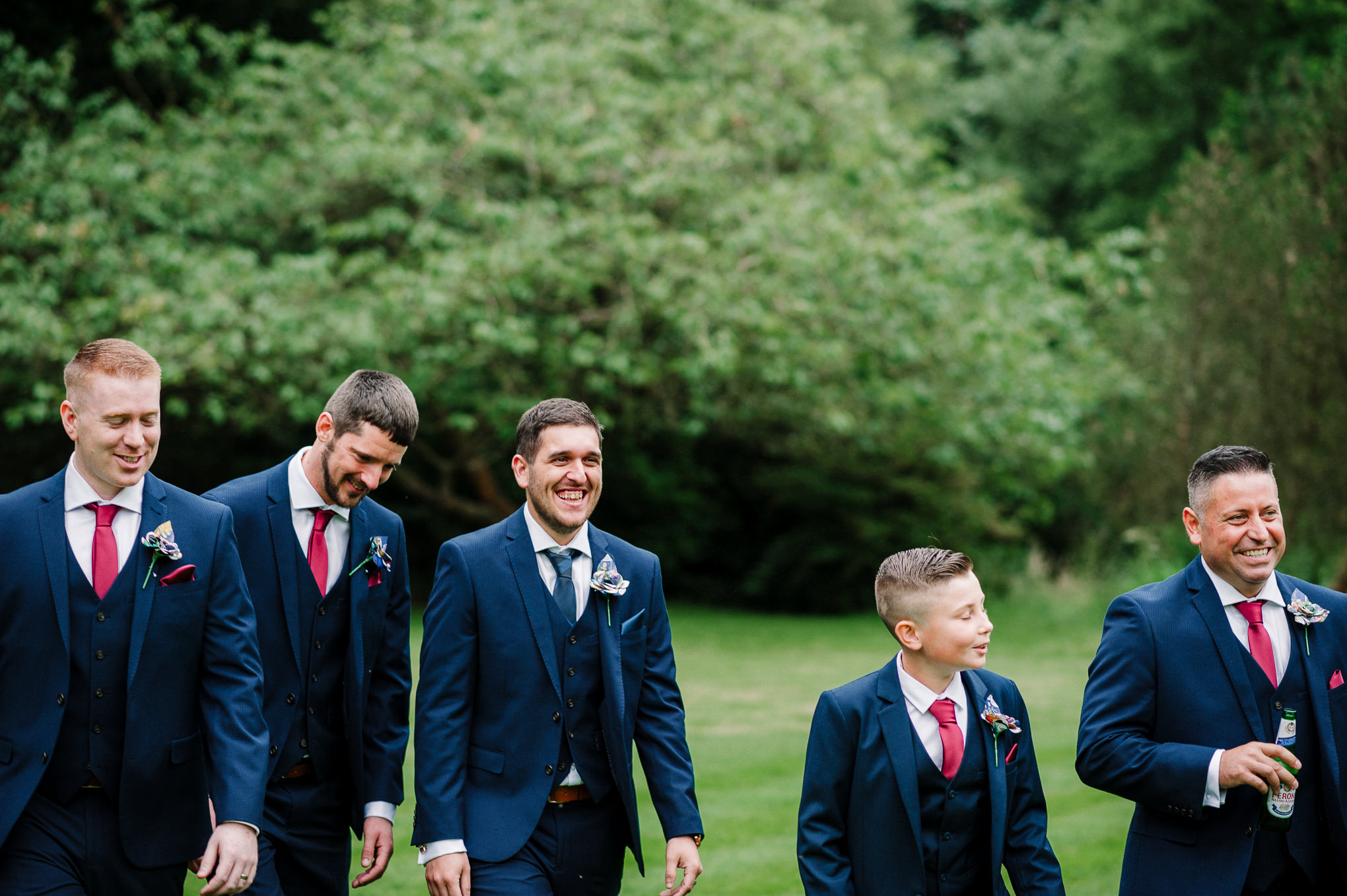 Close up photo of groomsmen laughing. Natural wedding photography