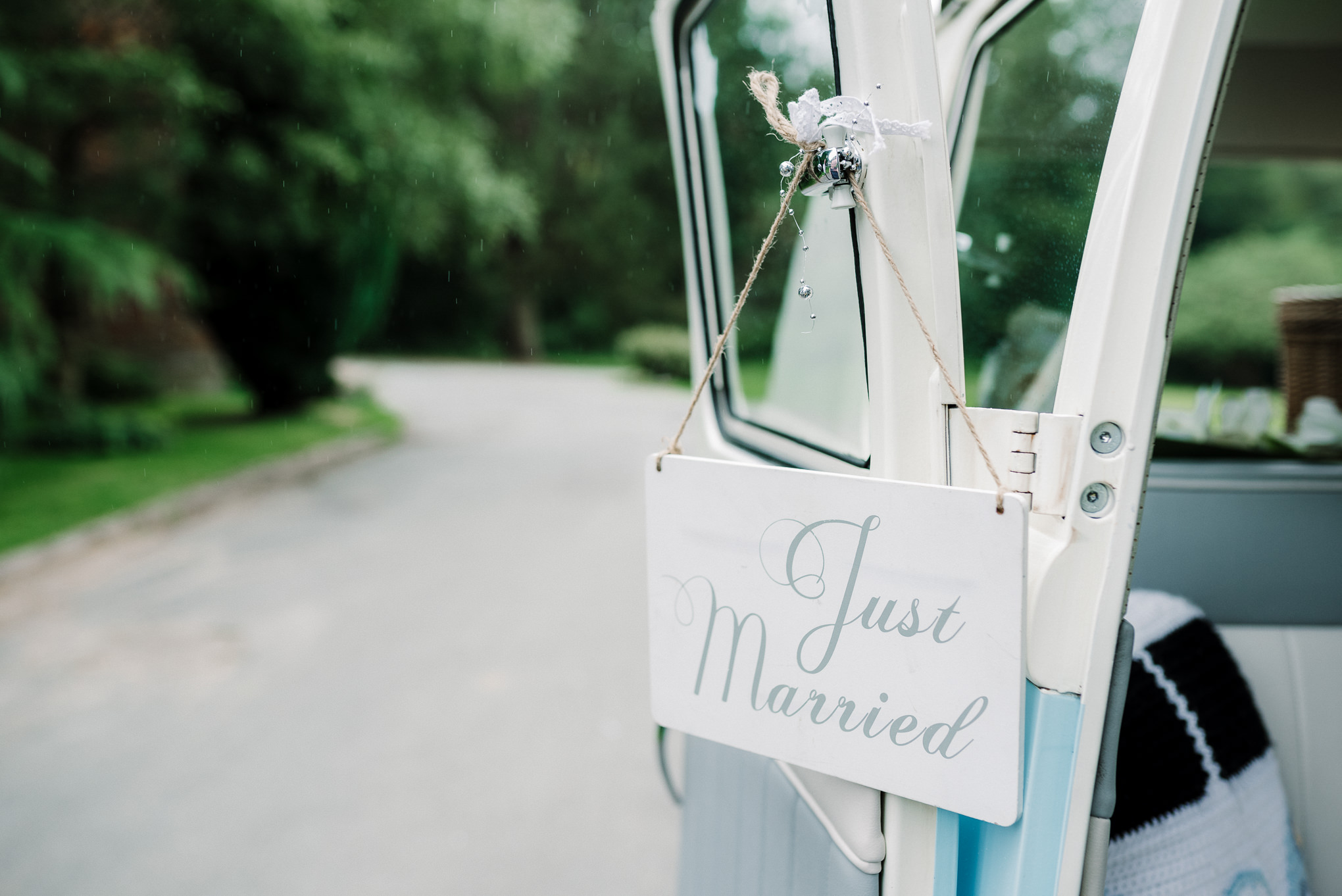Just married sign hung on camper van door.