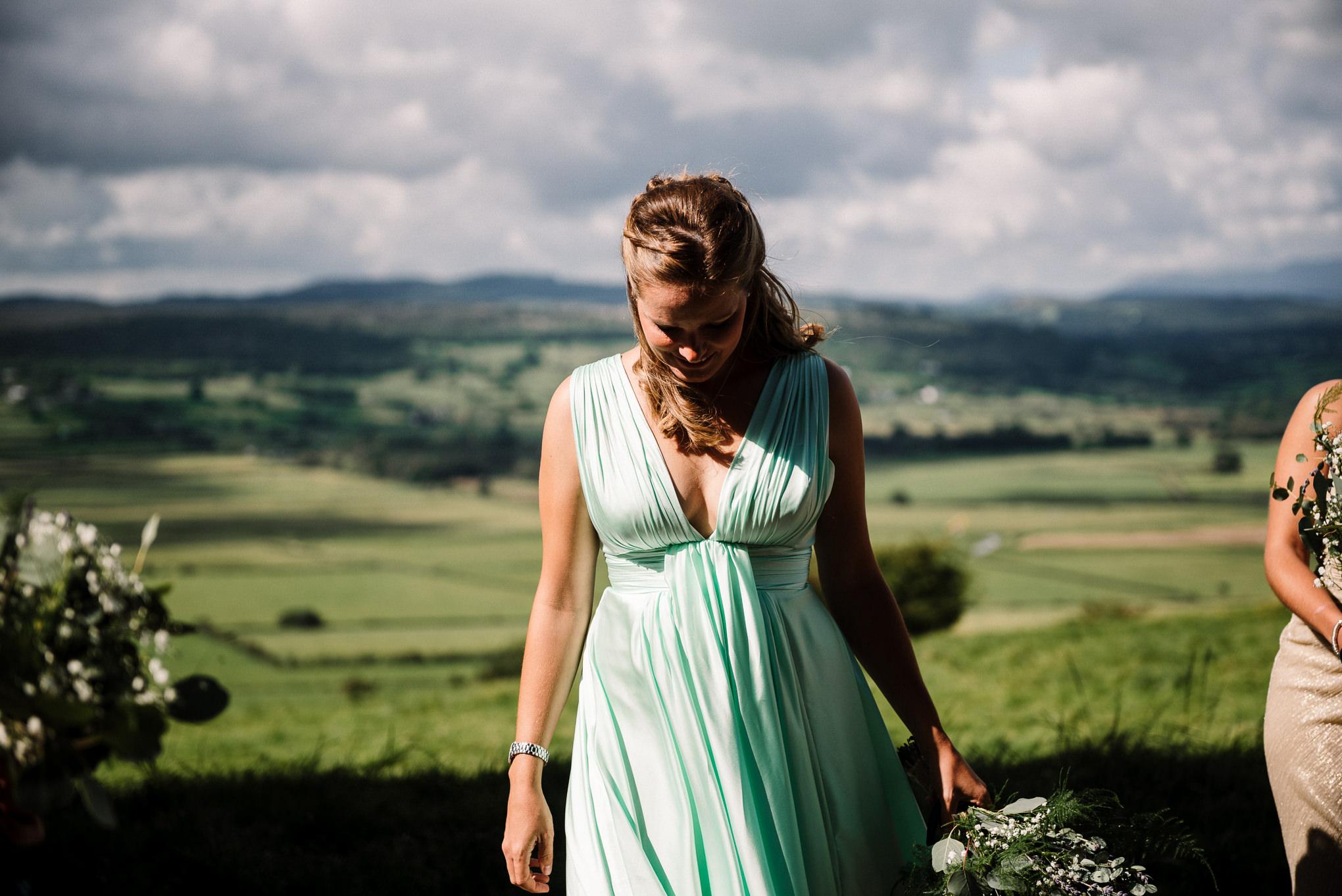 Natural shot of bridesmaid walking towards church
