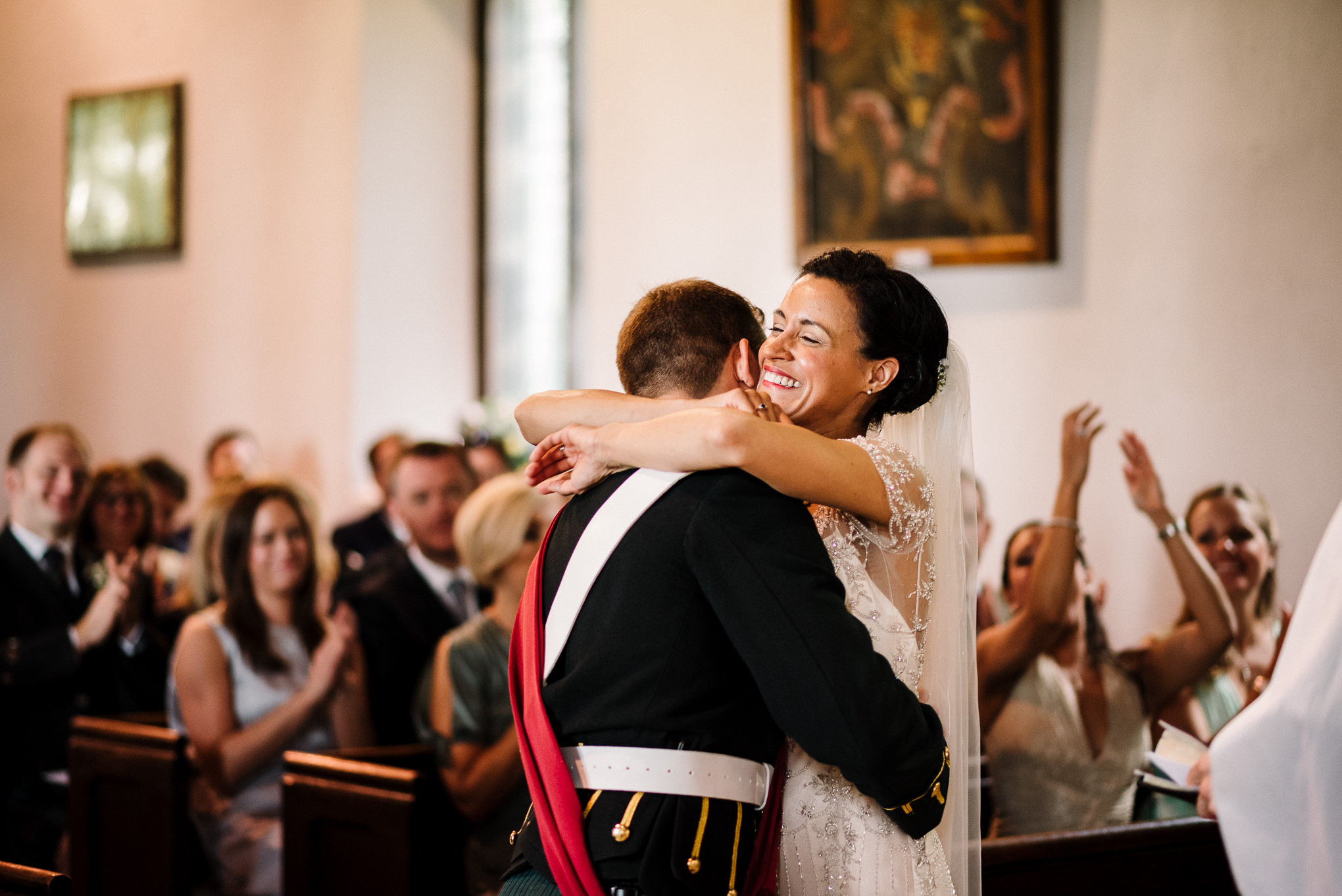 Bride and groom hugging during the ceremony at Brigsteer. Lake District wedding photography