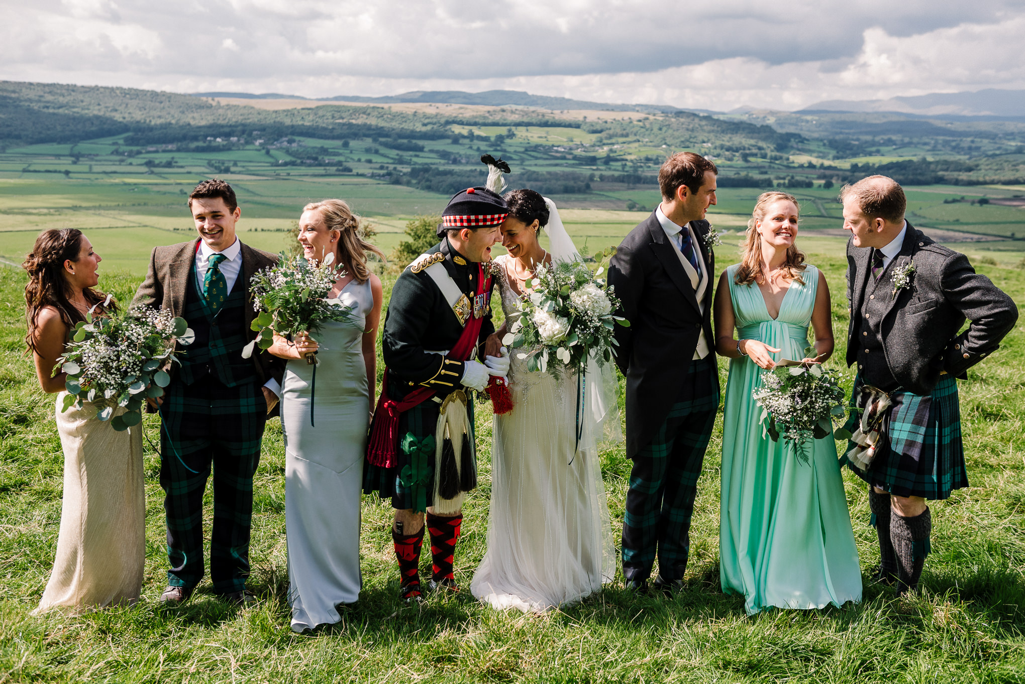 Natural photo of bridal party on the hillside. Lake district wedding photography