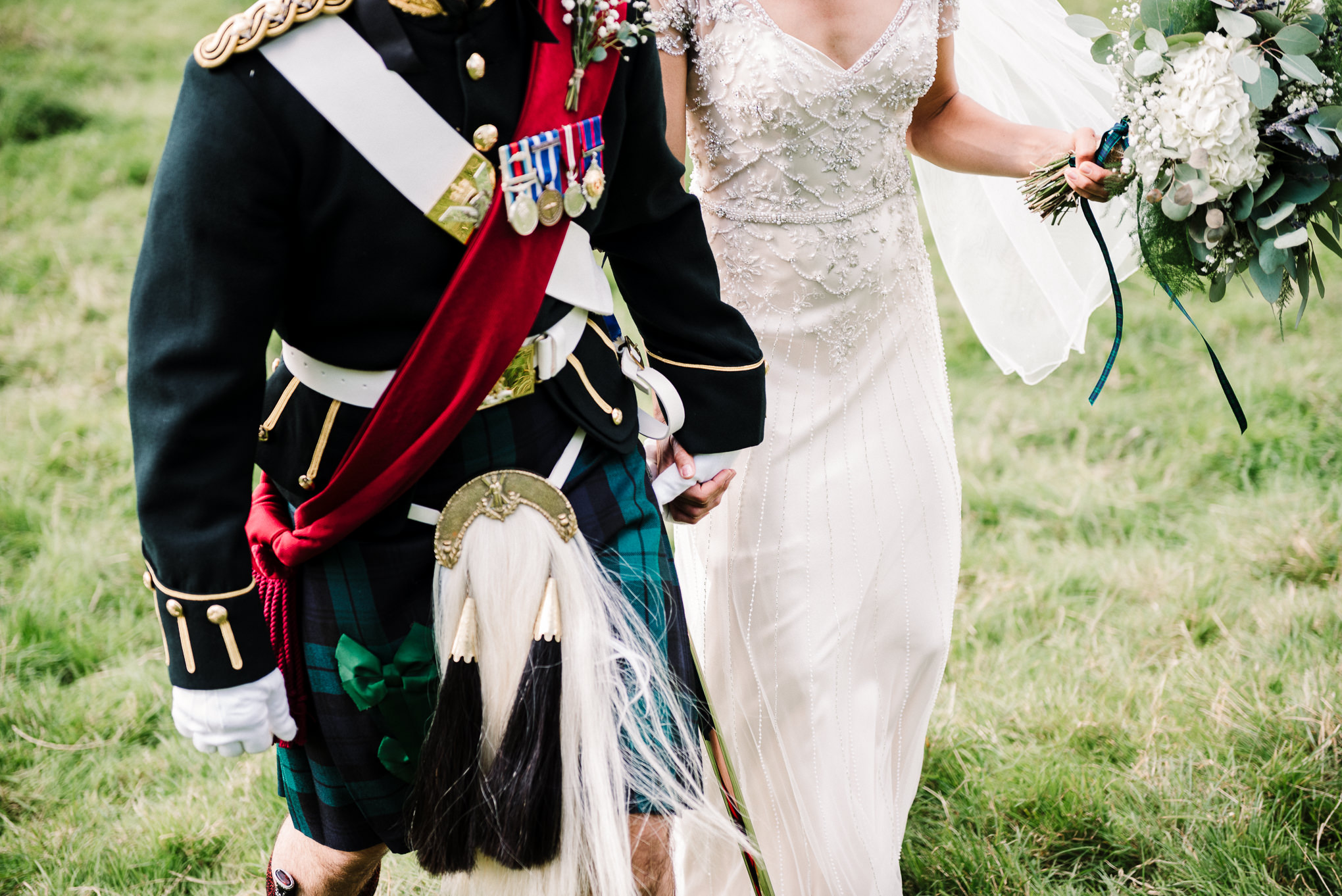 Close up photo of grooms military uniform.