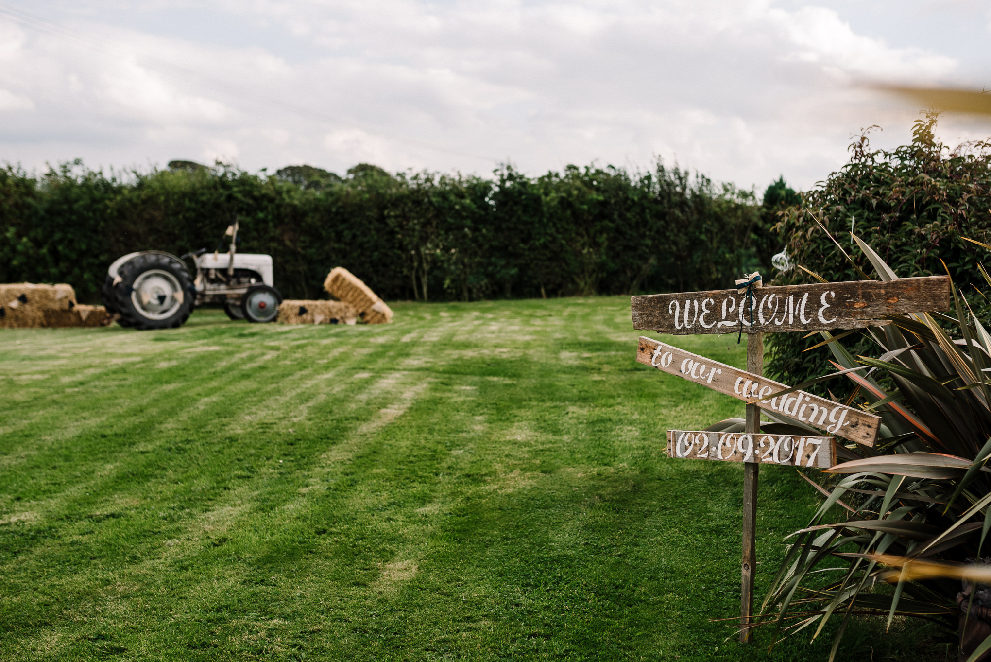 Tractor and rustic wood sign on the farm