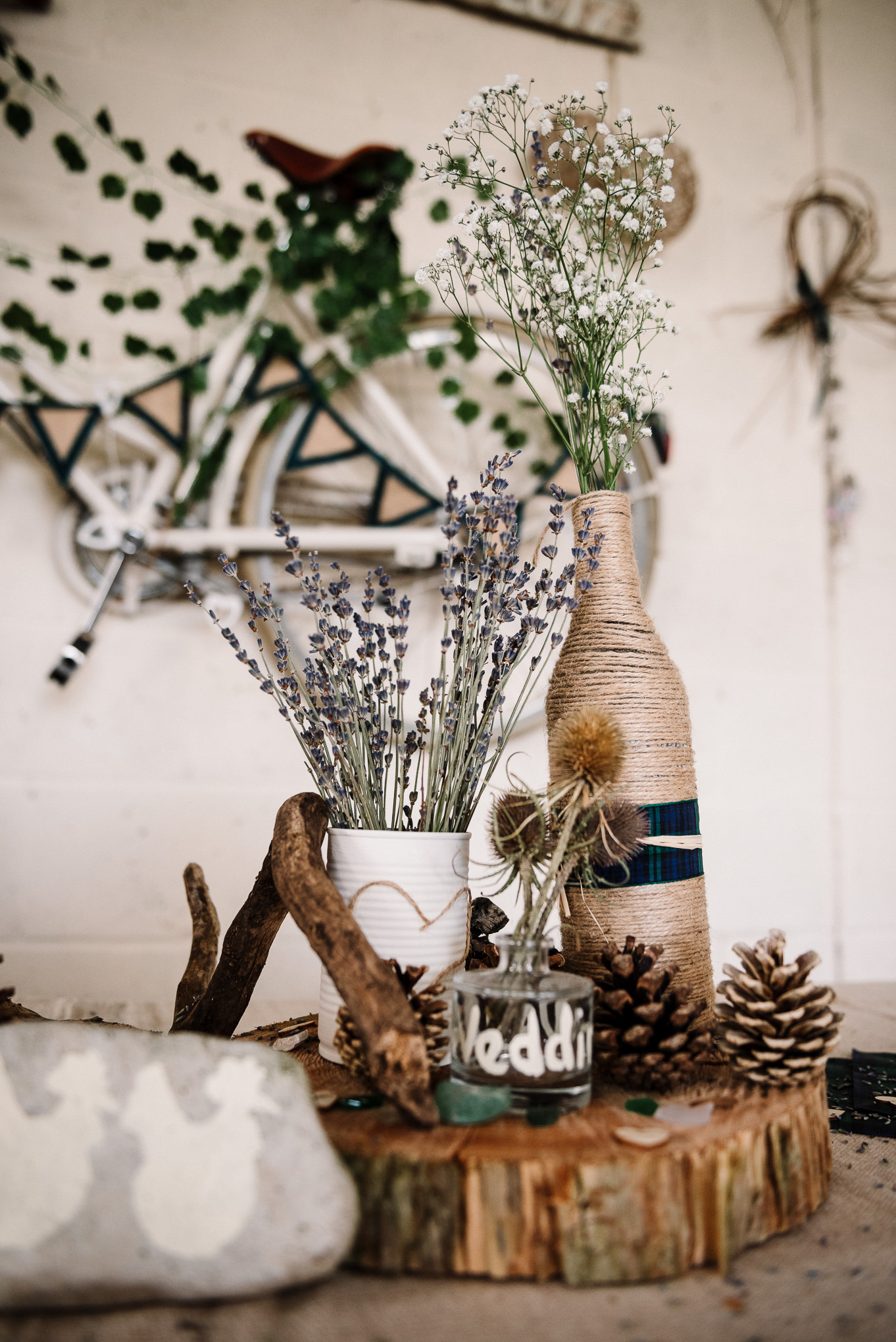 Rustic table centre piece with pine cones. Lake District wedding photographer