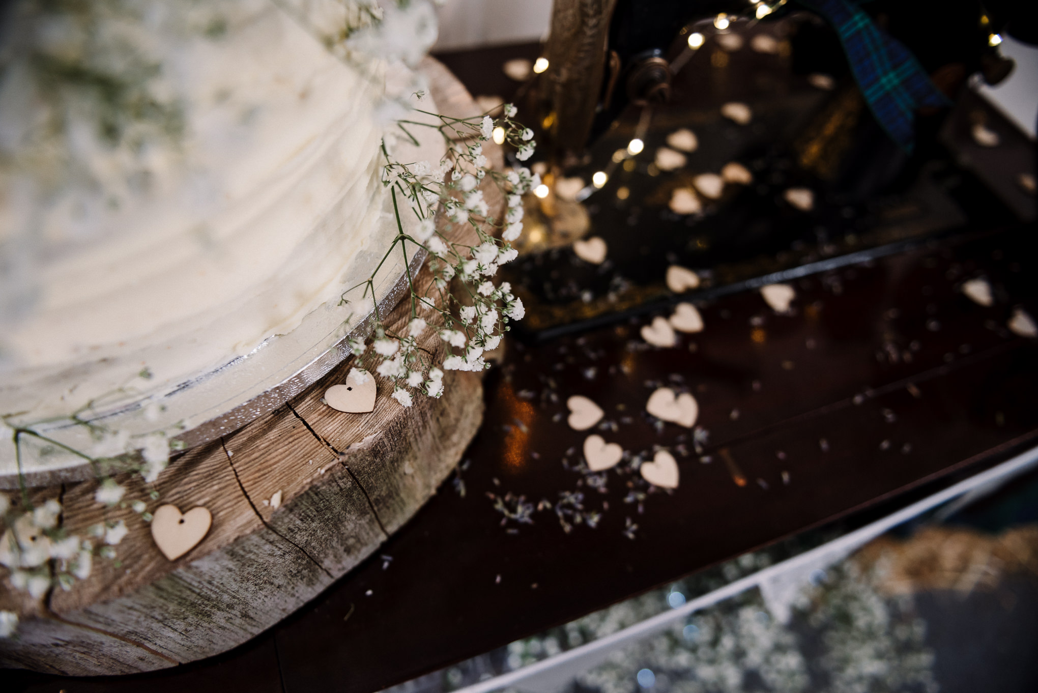 Close up photo of rustic wedding cake and gypsophila