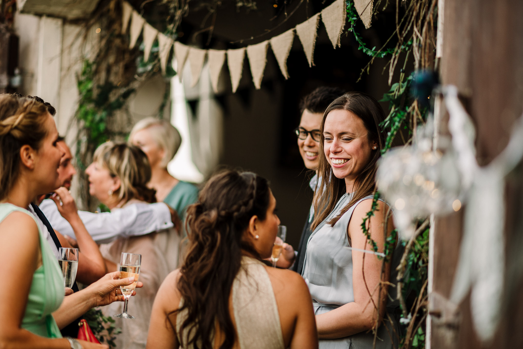 Natural shot of guests chatting on the farm