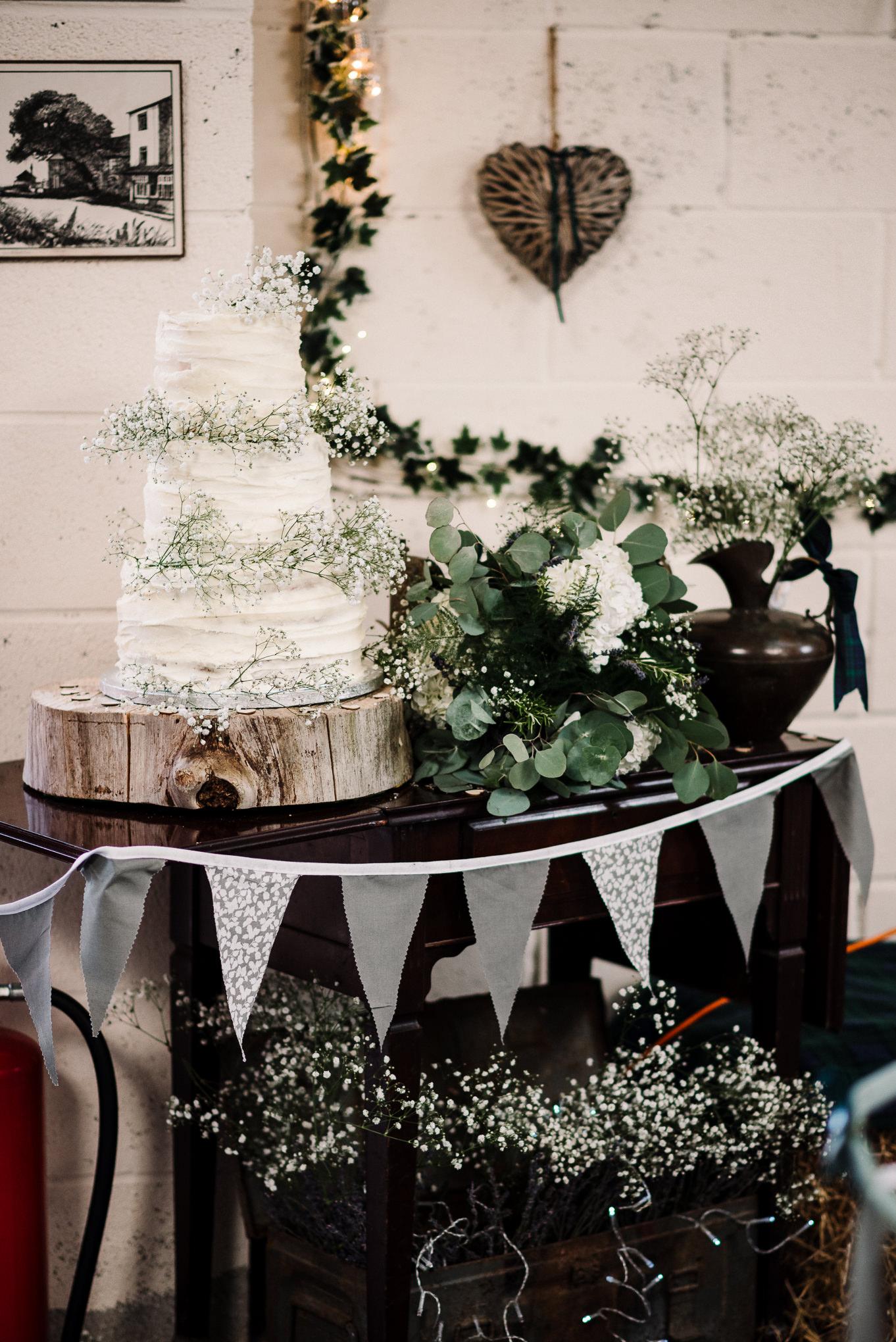 Rustic themed wedding cake. Lake District wedding photographer