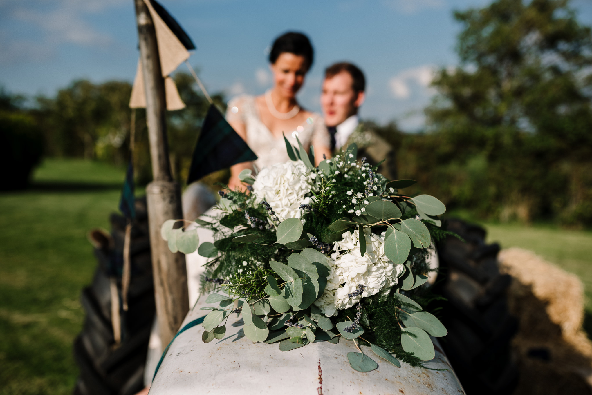 Bouquet on the tractor. Lake District wedding photographer