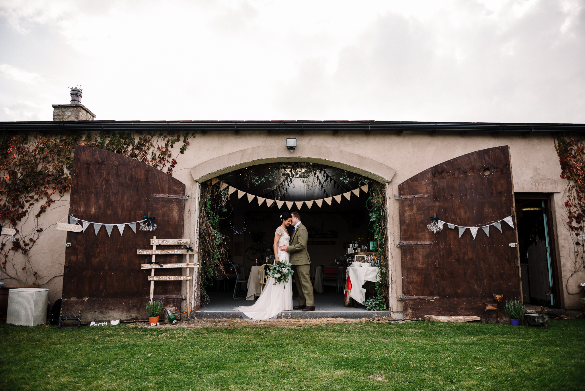 Bride and groom outside of the barn