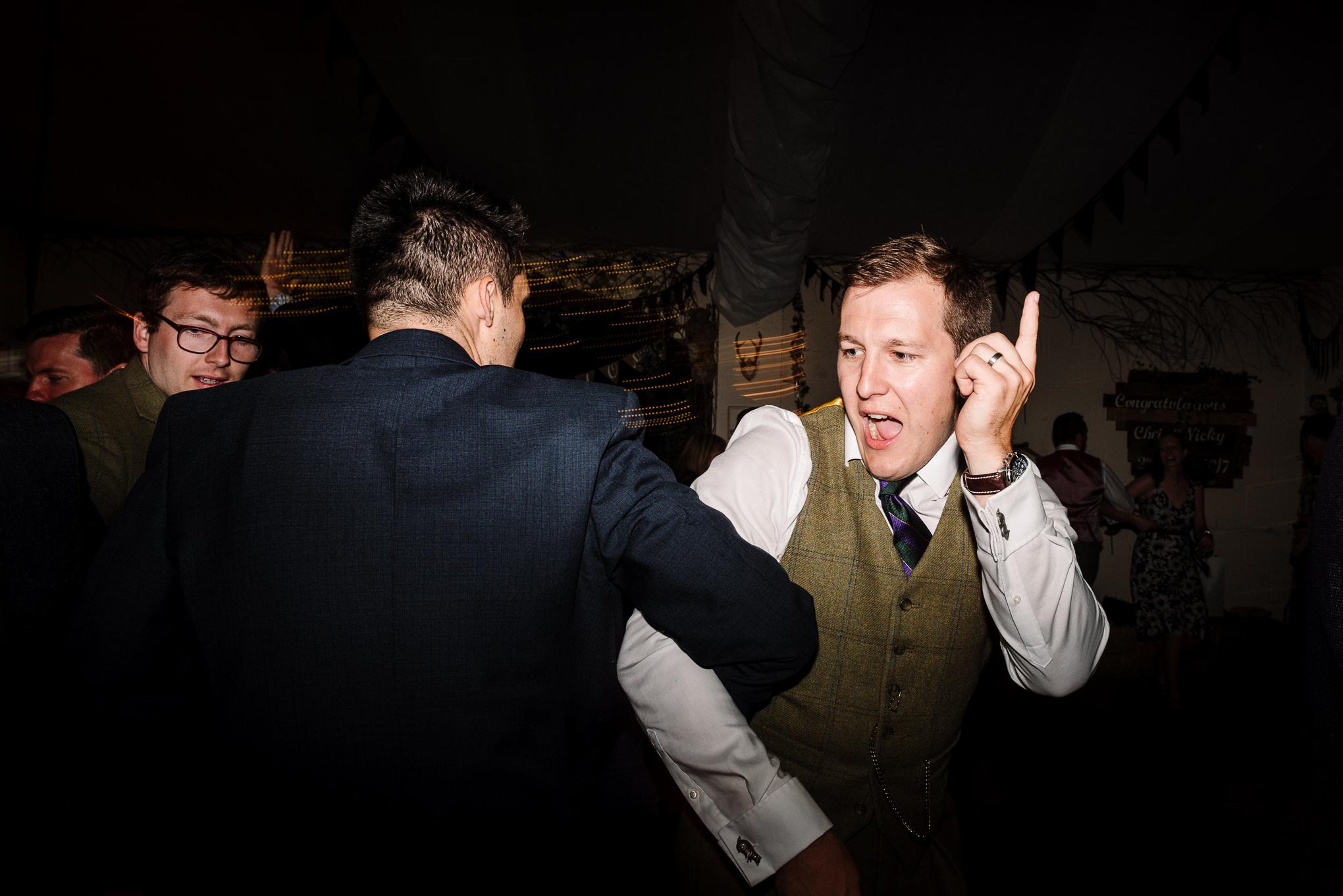 Groom on dance floor. Fun wedding photography