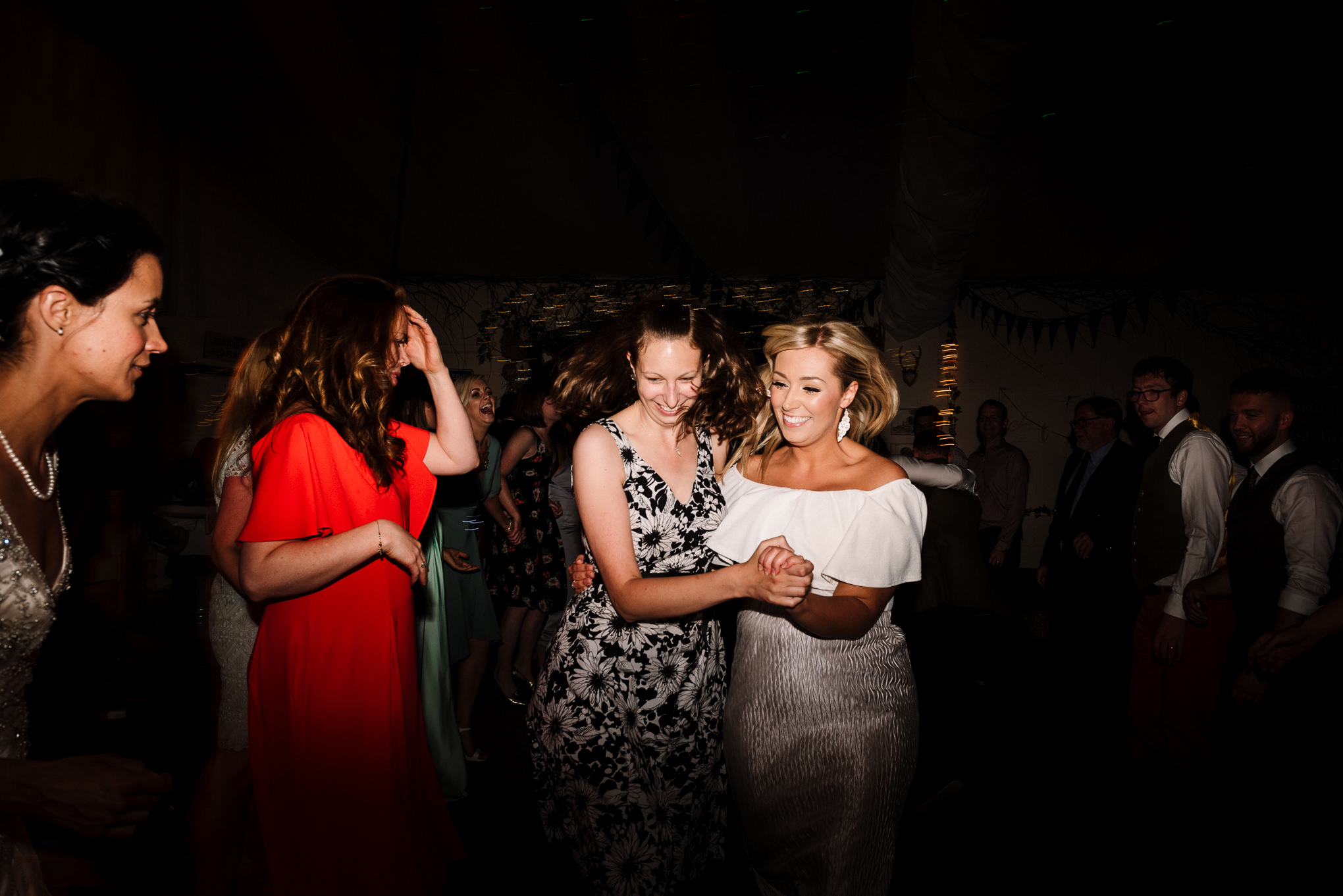 Ceilidh dancing. Natural wedding photography