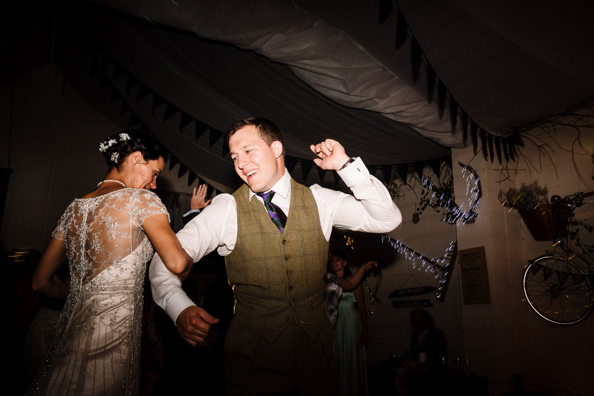 Bride and groom dancing to Ceilidh. Farm wedding photography