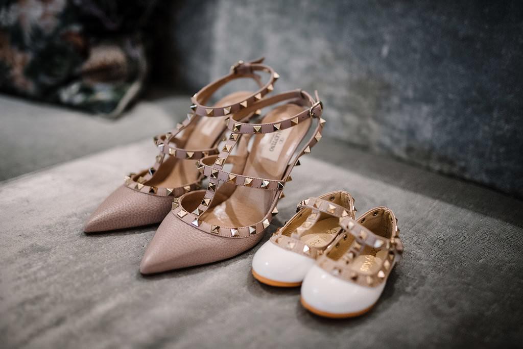 Brides Valentino wedding shoes next to daughters. Lancashire wedding photography