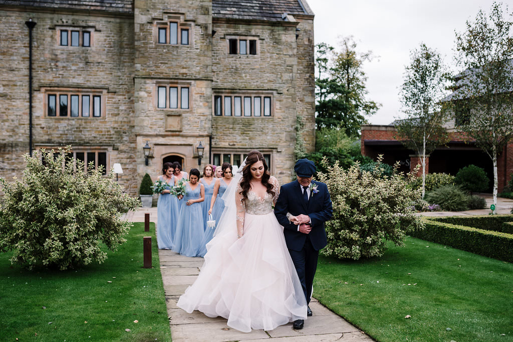 Bride walking to wedding ceremony with her Dad at Stanley House Hotel. Lancashire wedding photography
