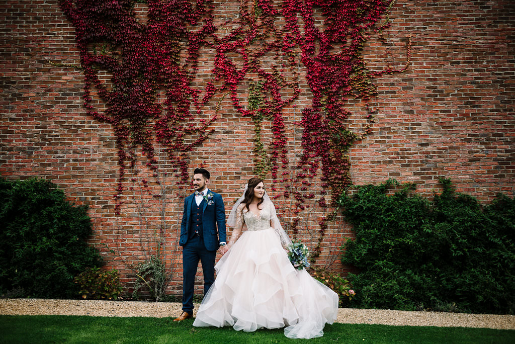 stylish portrait of bride and groom standing together
