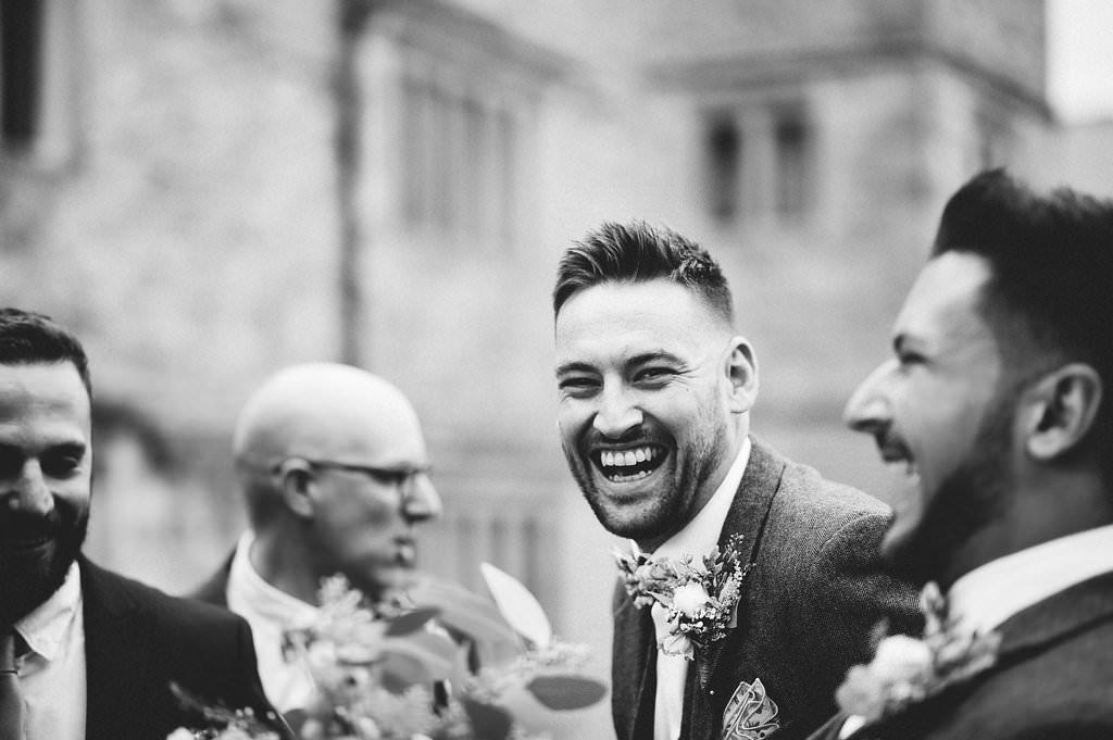 Natural shot of best man laughing. Lancashire wedding photography