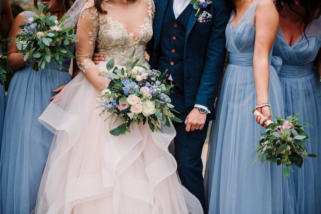 Detailed shot of brides and bridesmaid dresses.