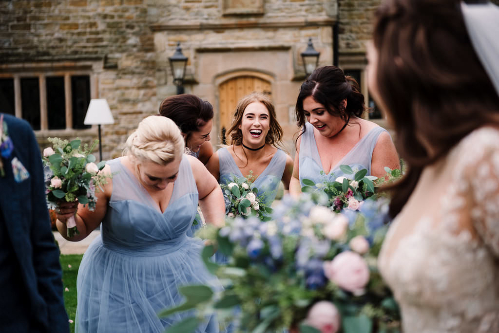 Colourful photo of bridesmaids outside at Stanley house hotel