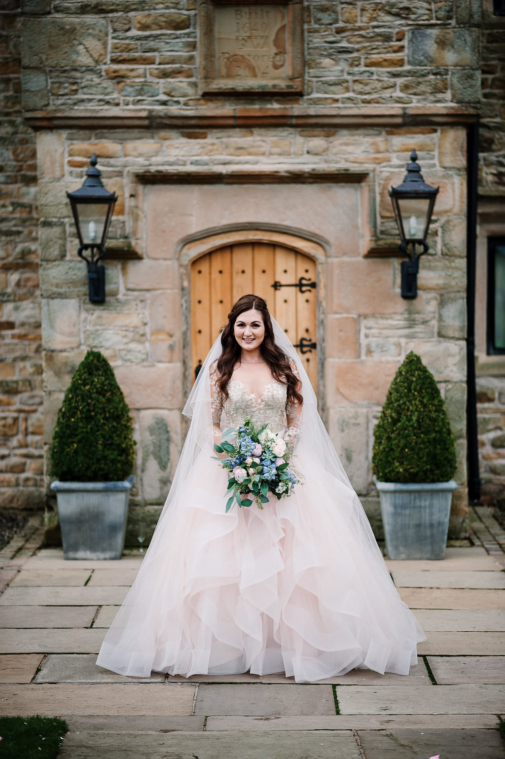 Bride stood in front of Stanley House in her Hayley Paige wedding dress. Lancashire wedding photography