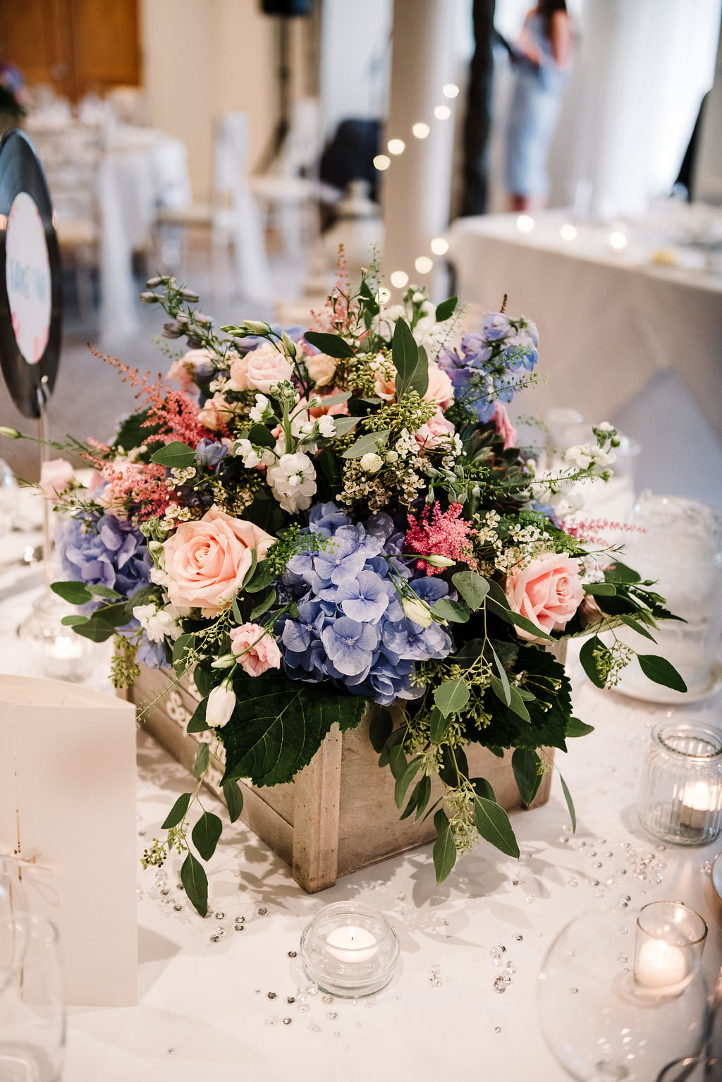 Table centre piece. Flowers in wooden crates