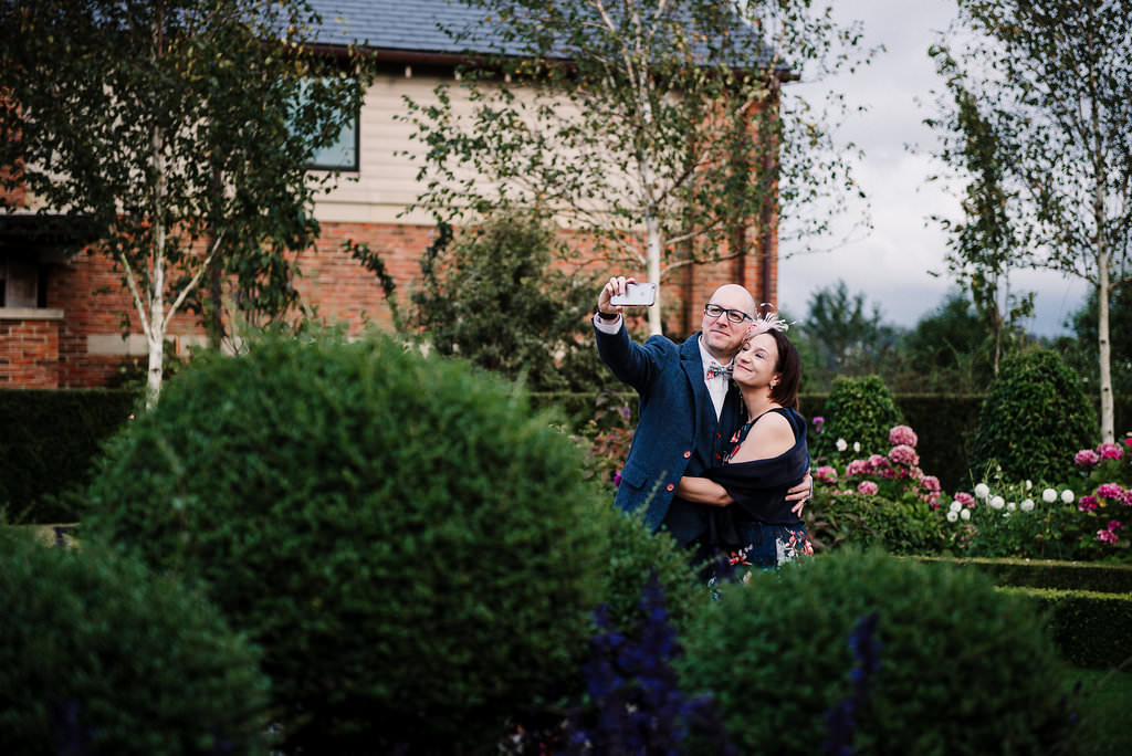 documentary photo of wedding guests taking selfie